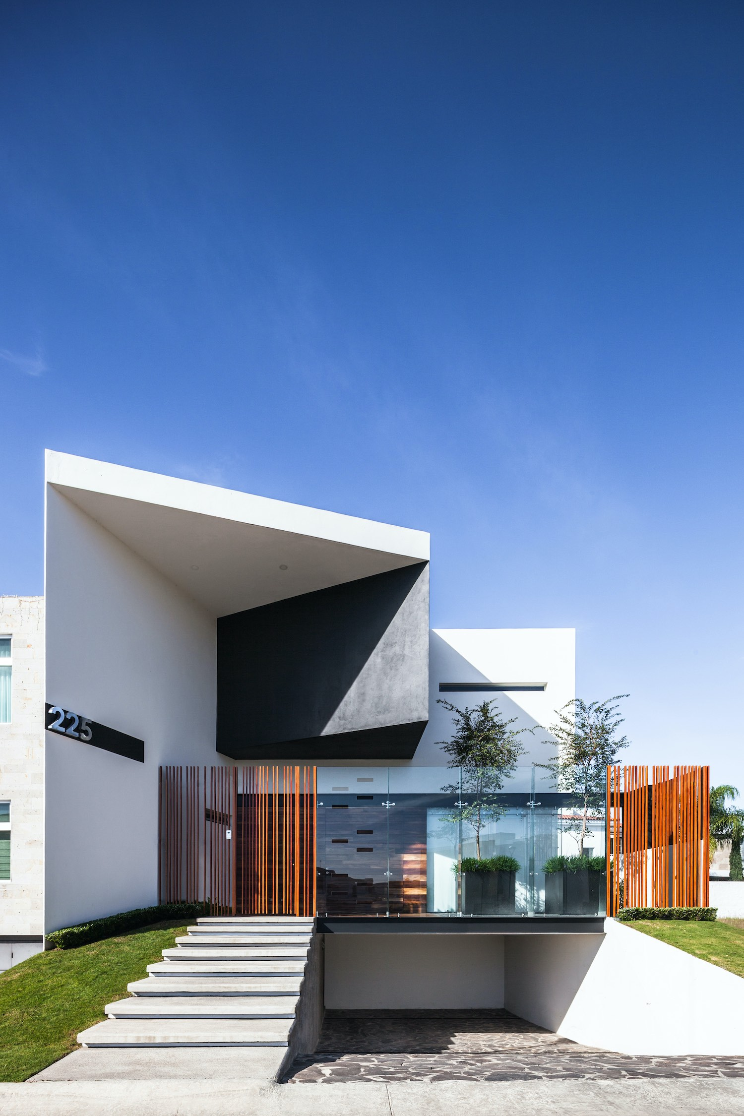 modern house with concrete staircase at the entrance