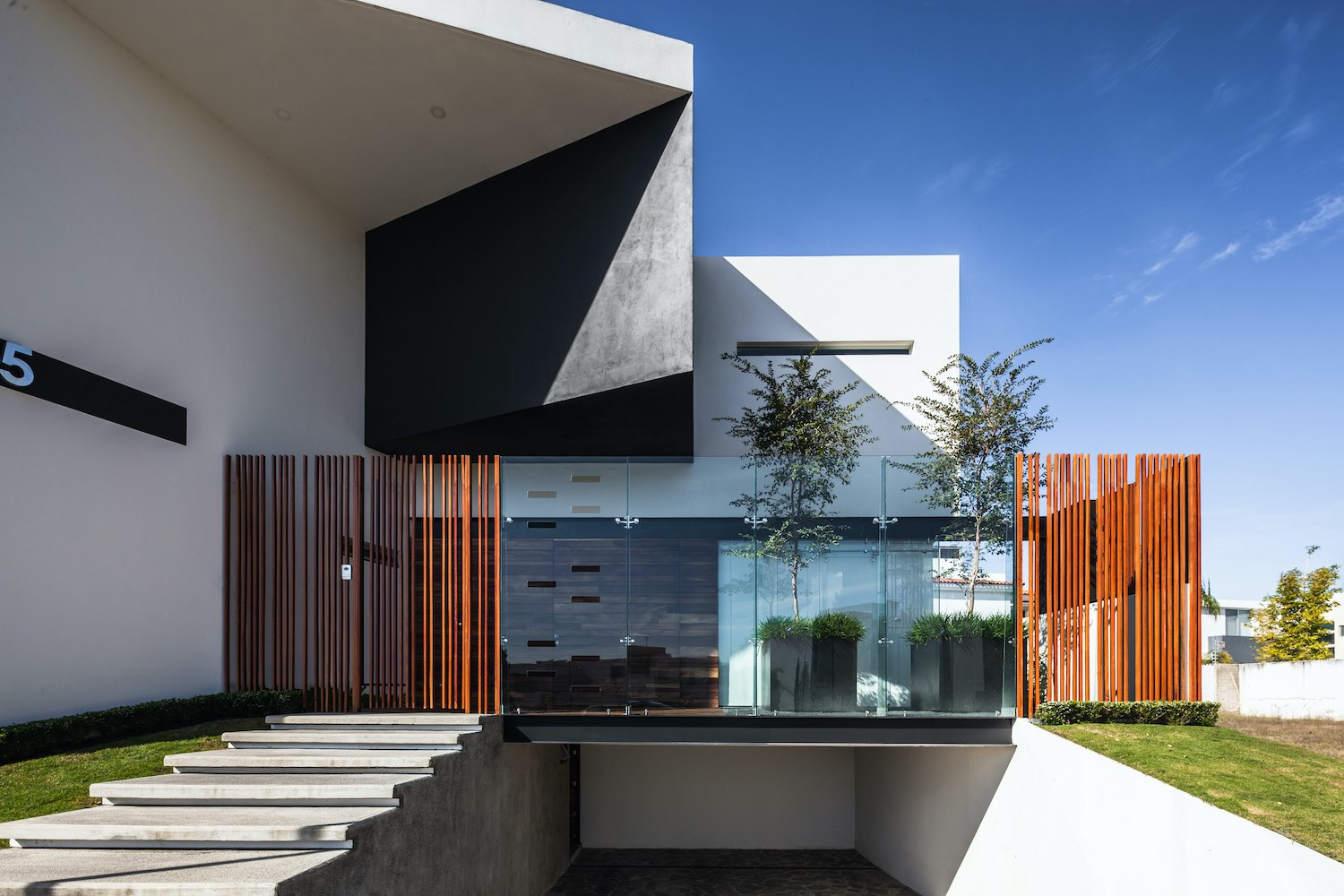 house facade with white stucco and glass