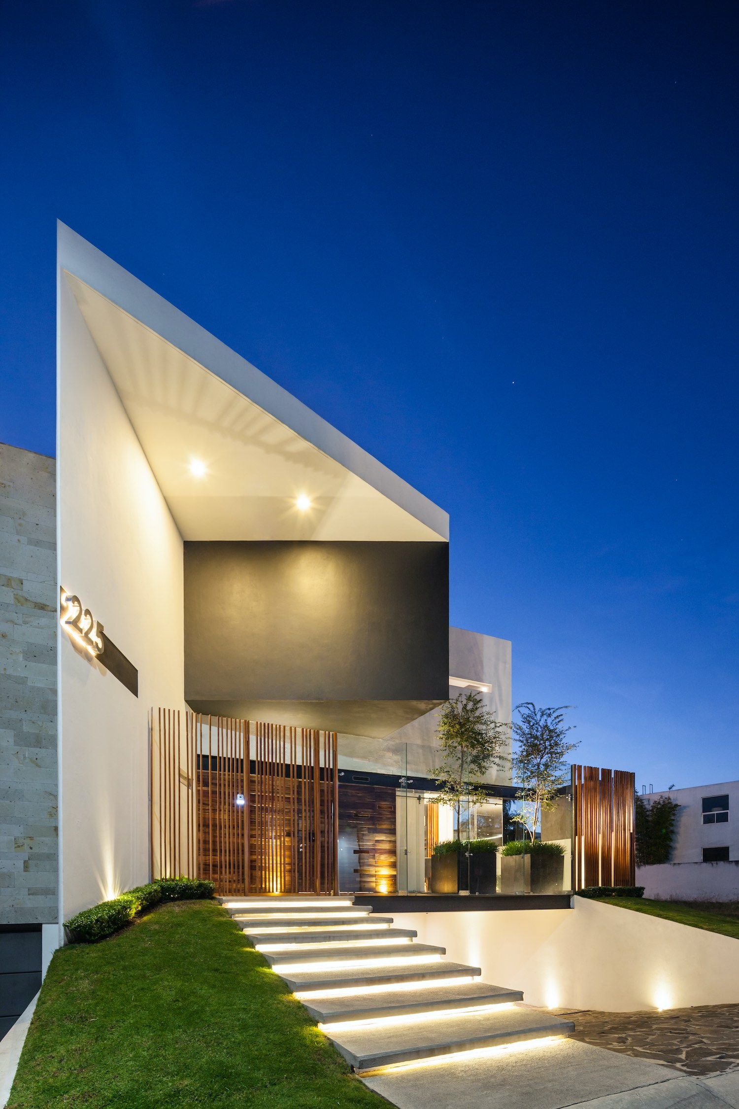 house illuminated with artificial lights at night