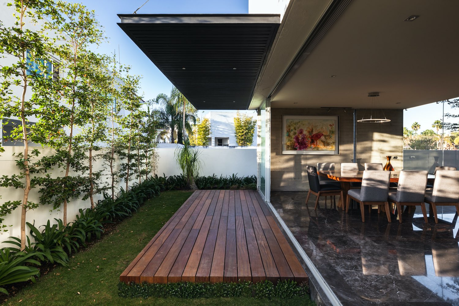 wooden deck at the backyard of the house