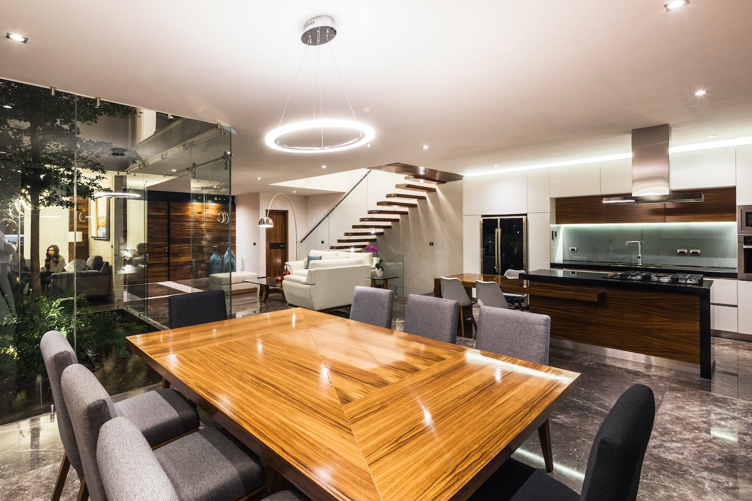wooden dining table and chairs at night