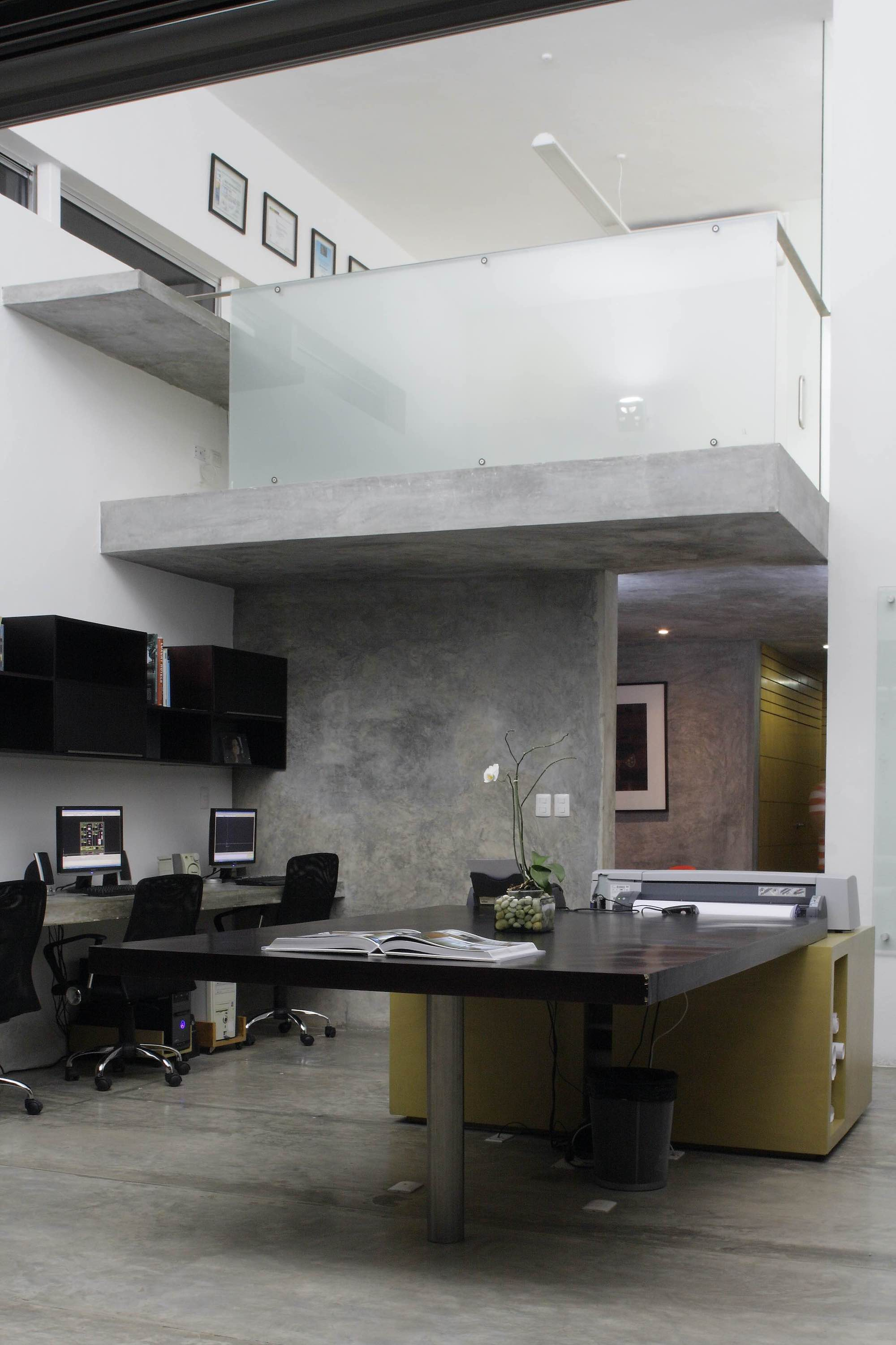 double height office space with computers and work desks
