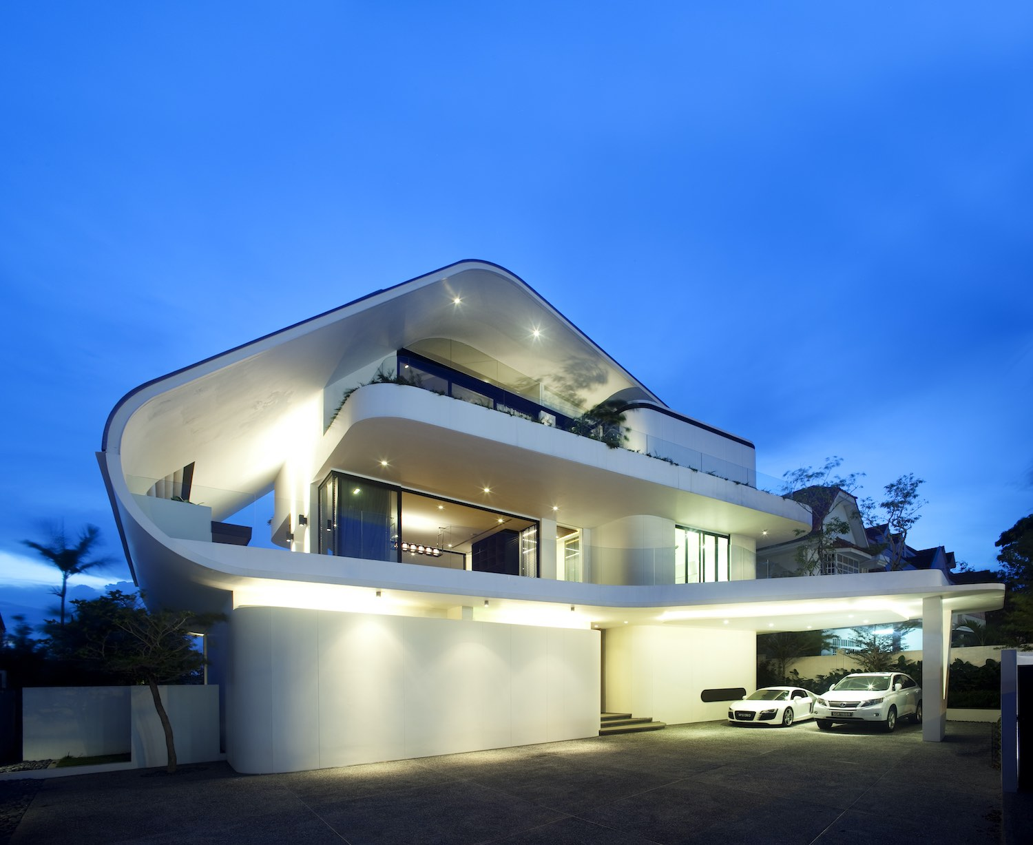 the curvy house illuminated with bulb lights at night