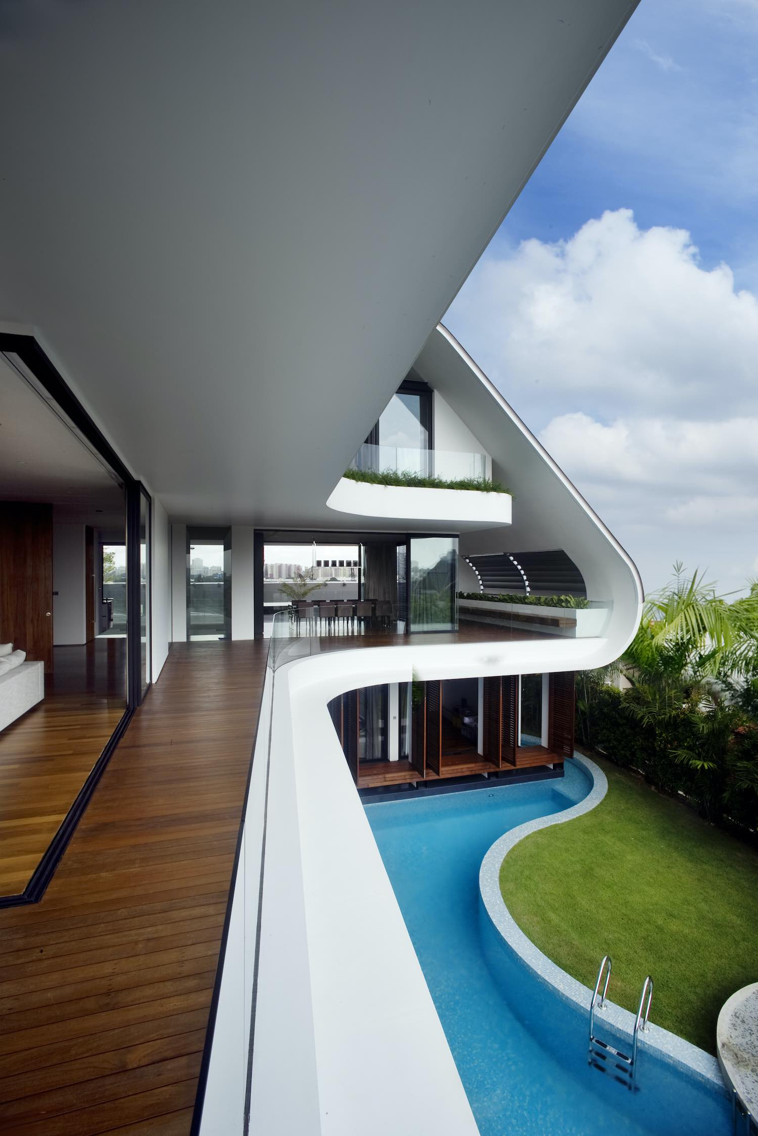 house with long balcony over pool