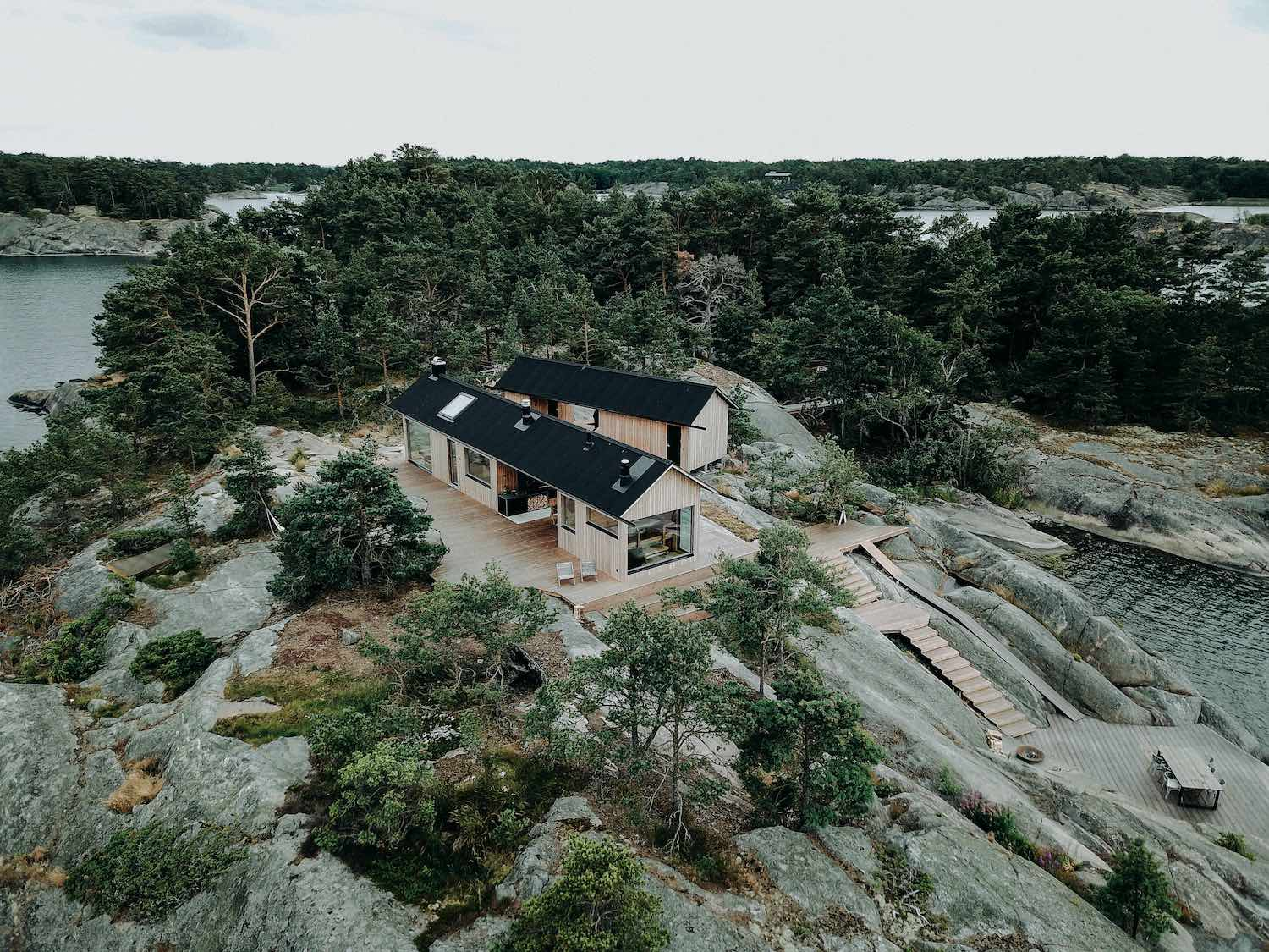 two cabins in a rocky island in Finland