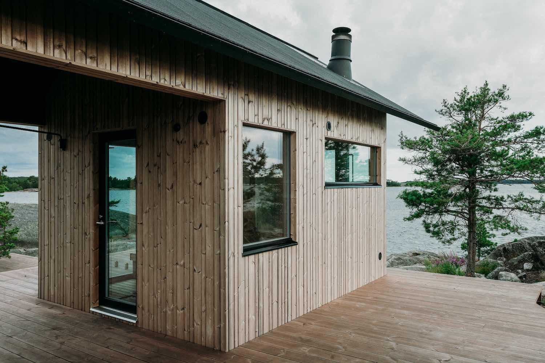 a modern wooden cabin house on an island