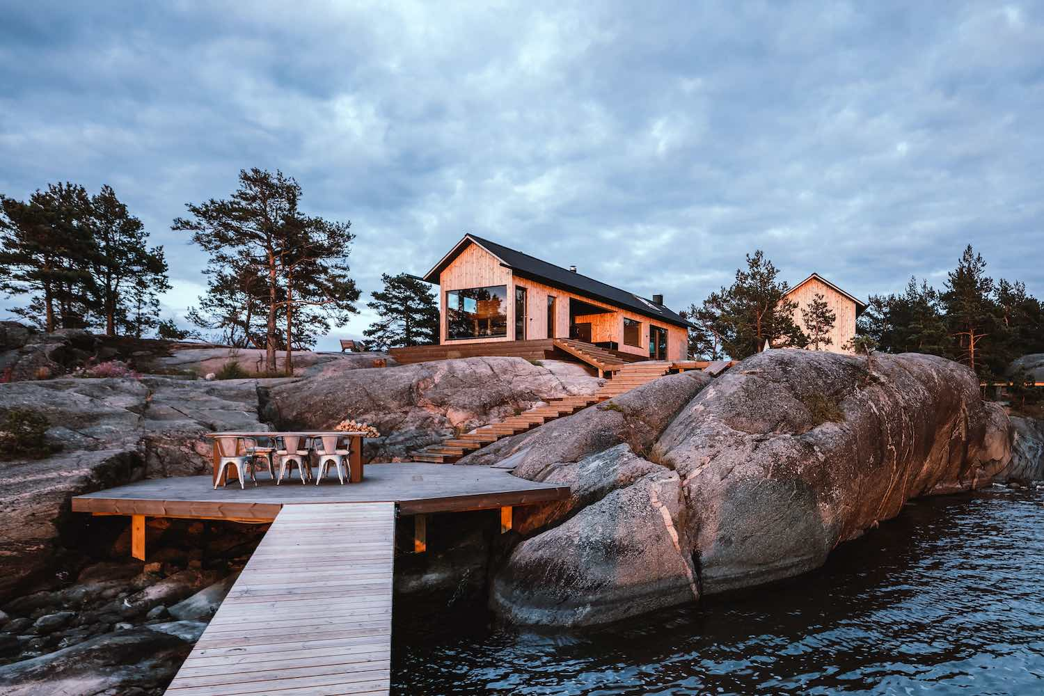 beautiful outdoor living space an a deck in an island with rocks on the edge