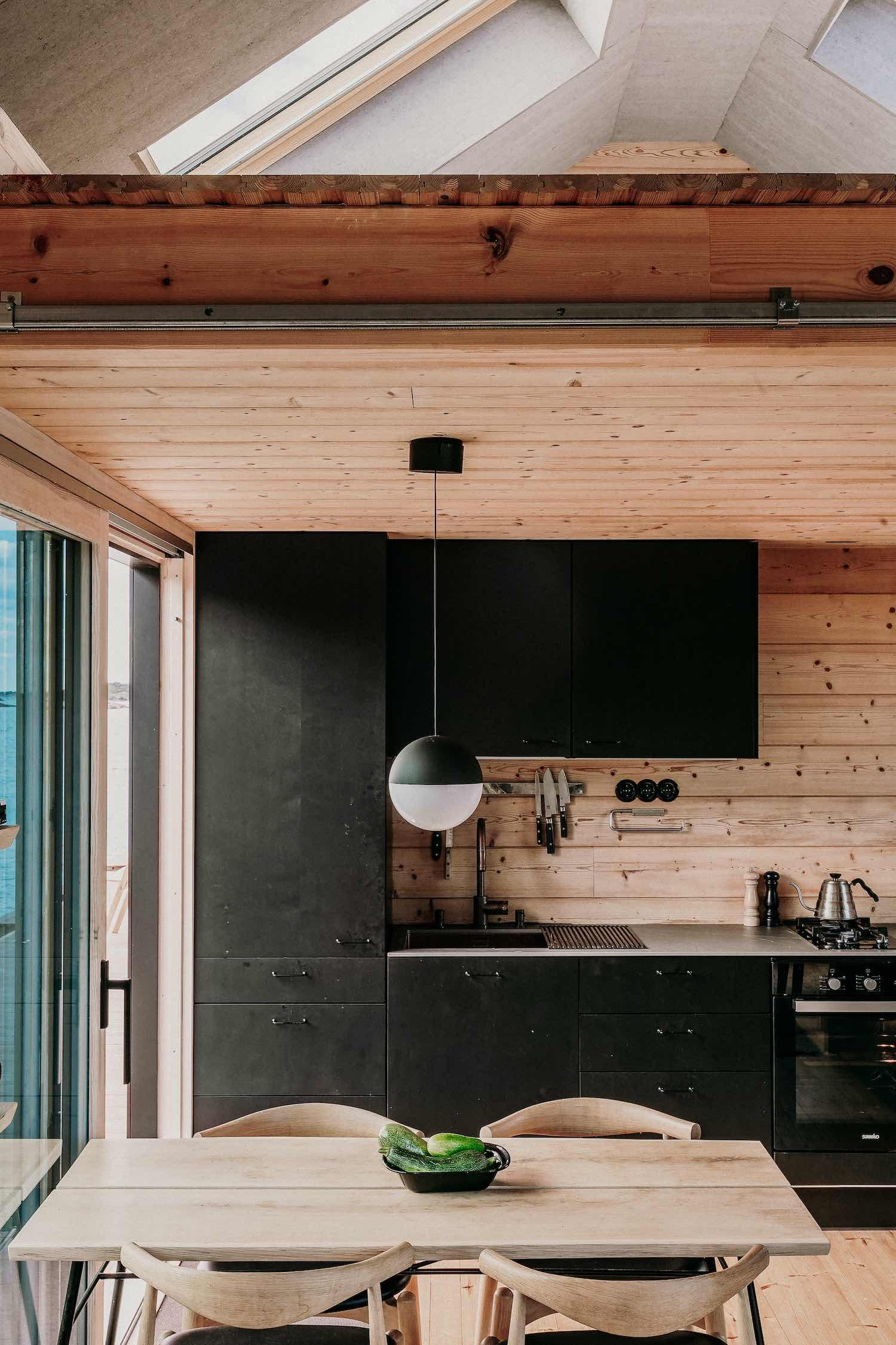 a modern black kitchen