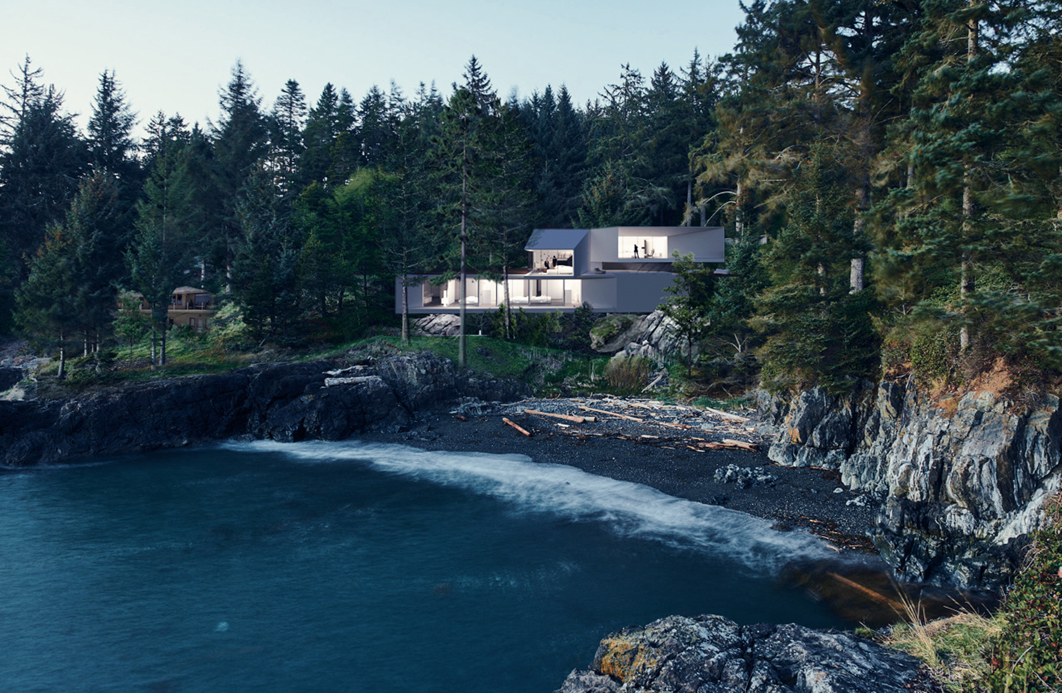 a seaside home on a cliff surrounded by pine trees