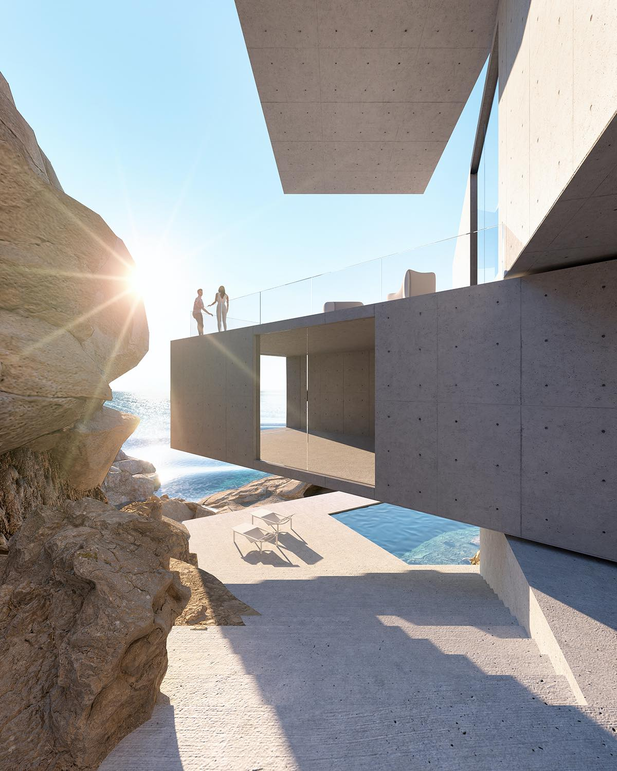 sun lights hitting a concrete house inside the cliff with beautiful large terrace