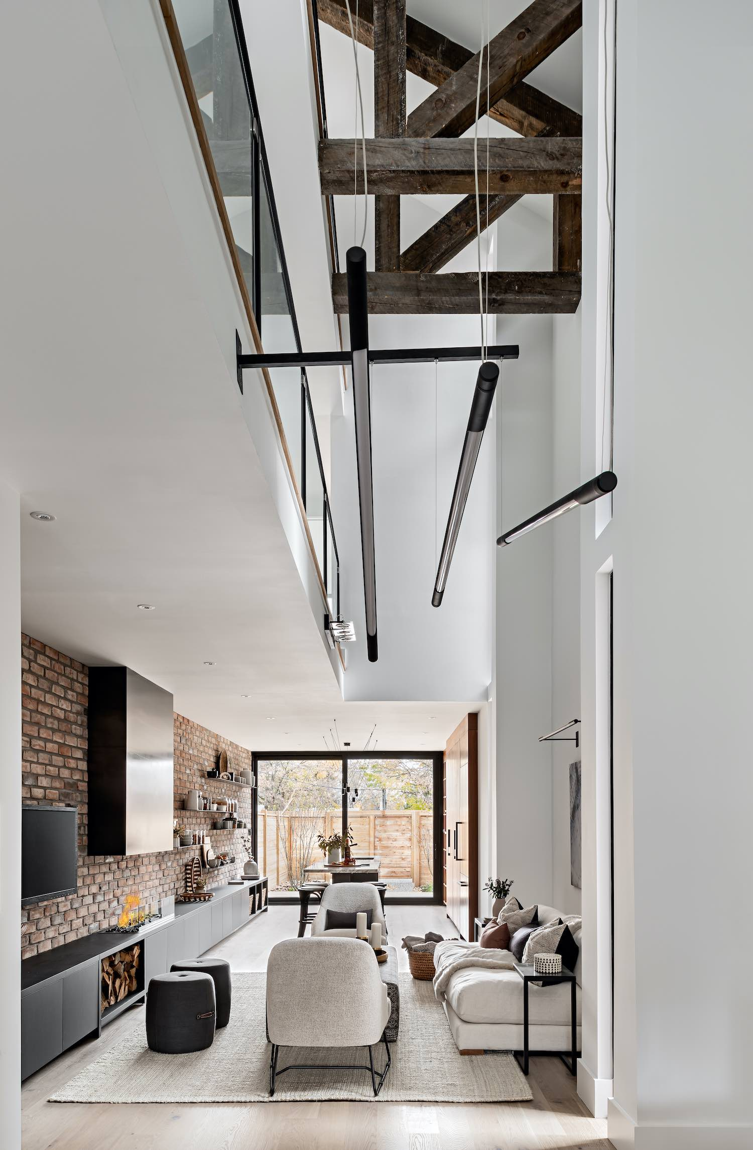 cozy living room with large windows and double volume roof