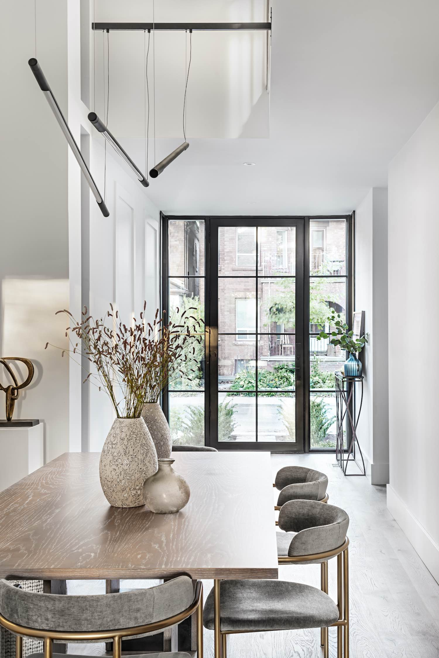 sunlights enters the dining area through large windows