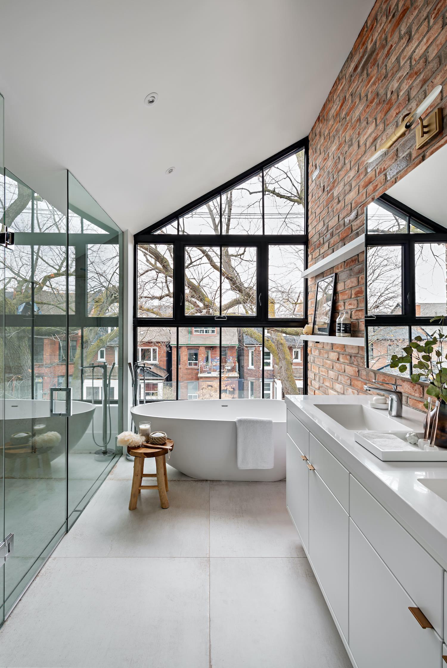 bathtub nearby window with a great city view
