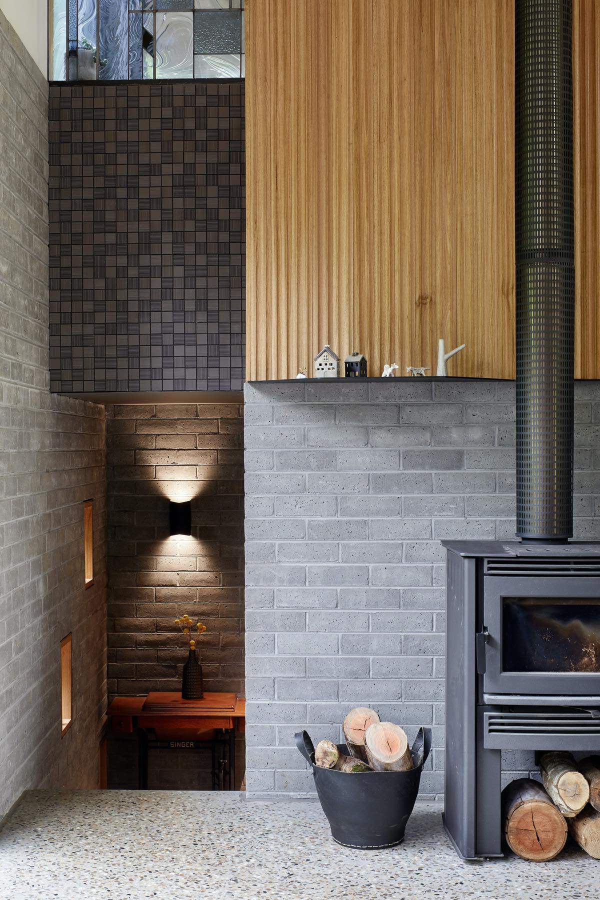 black metallic chimney with wall background made of concrete blocks