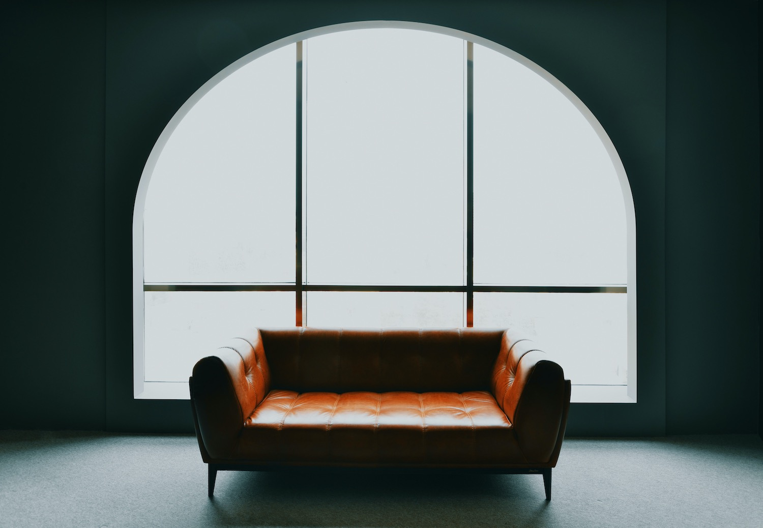 leather sofa near window