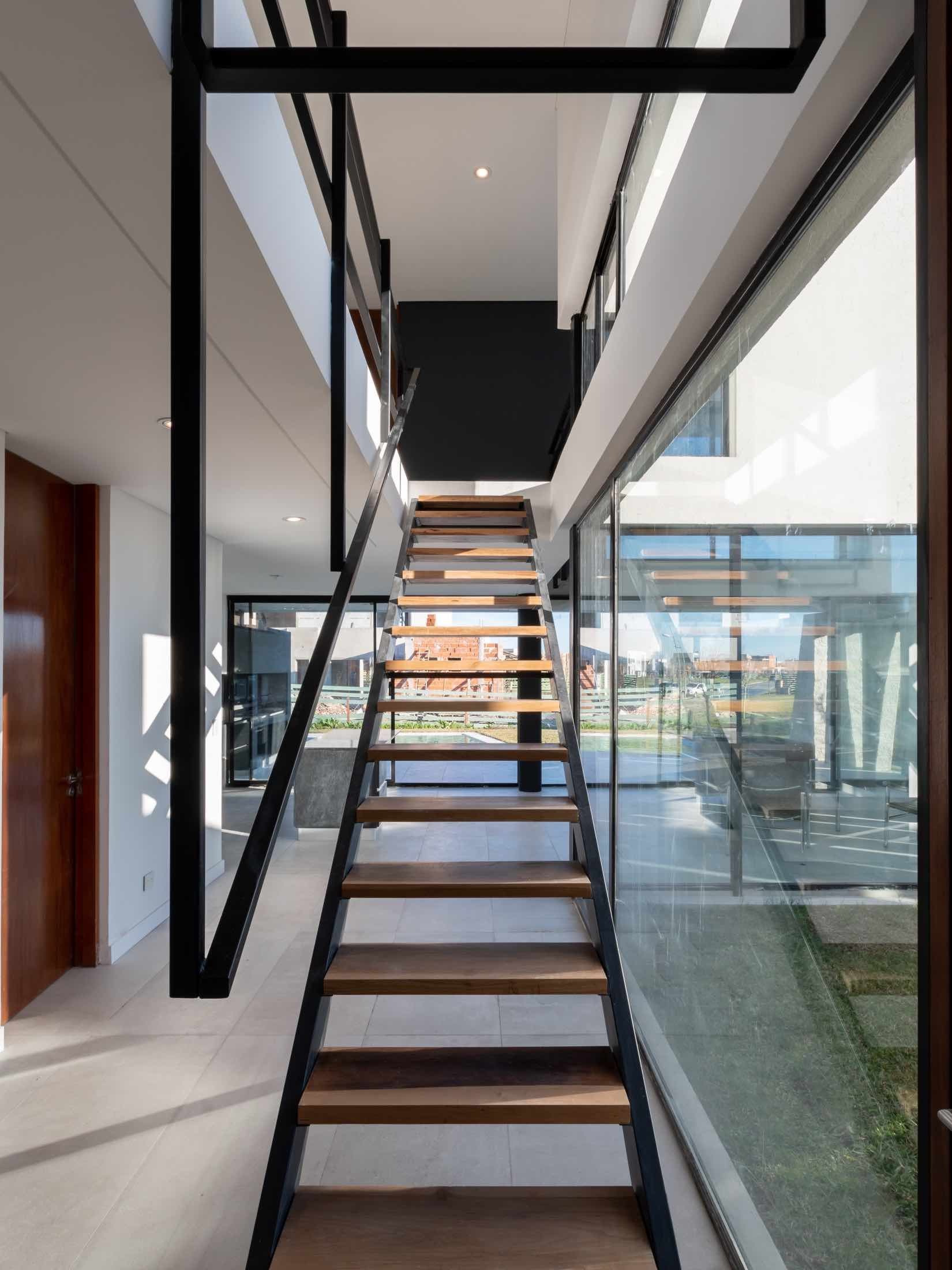 the wooden and steel staircase