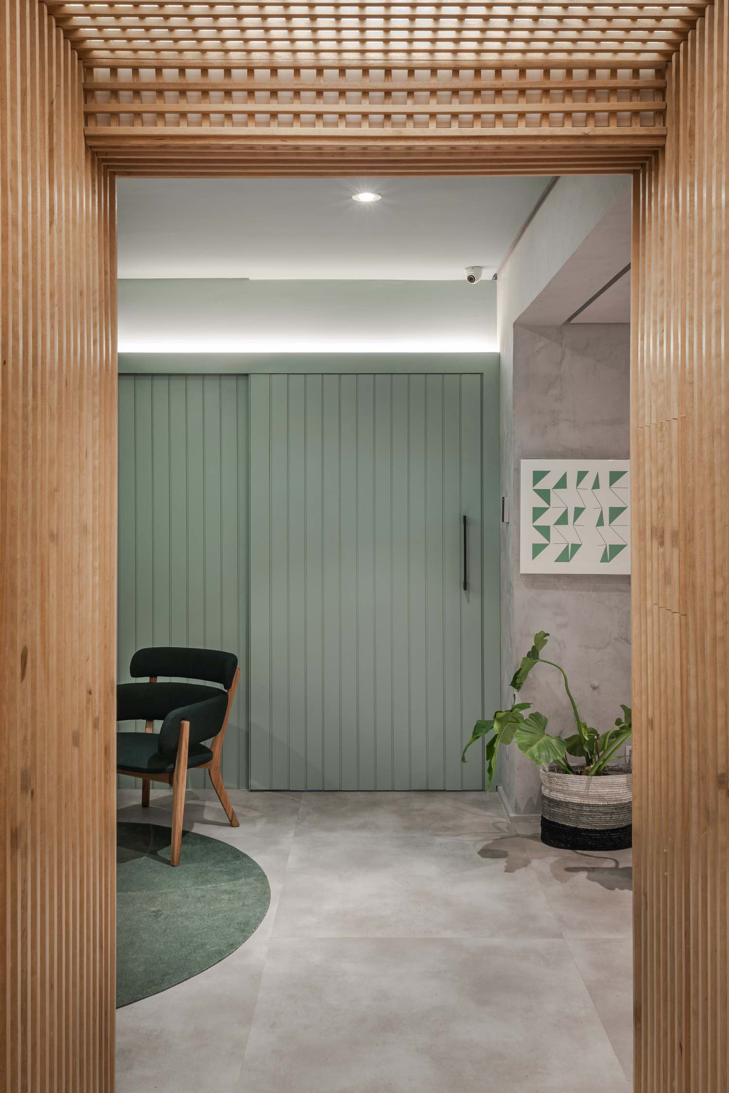green wall with green armchair
