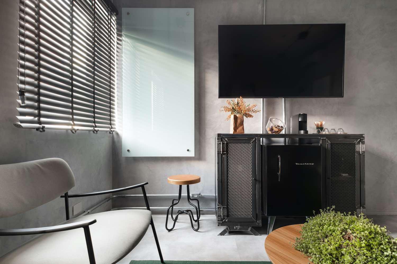 television hanged over black metal cabinet