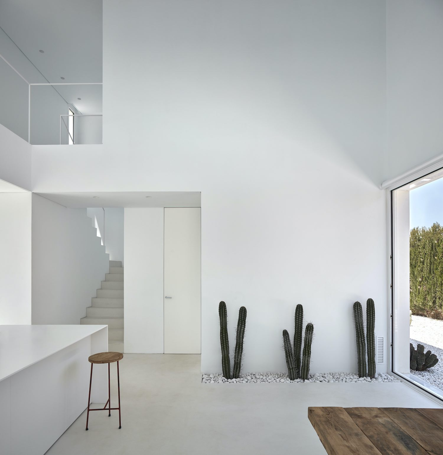 white living space with double volume ceiling