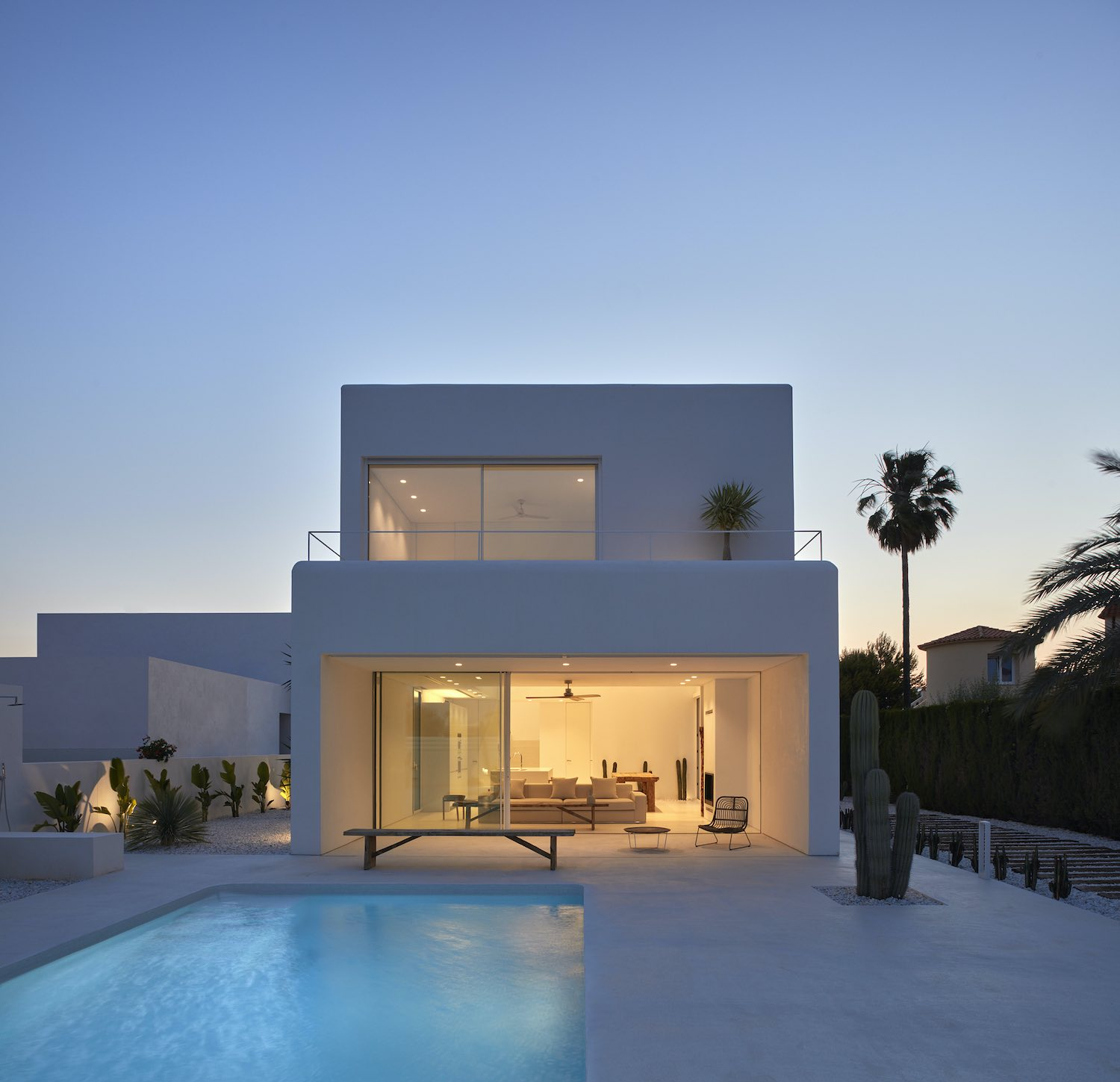 house with illumination and pool at night