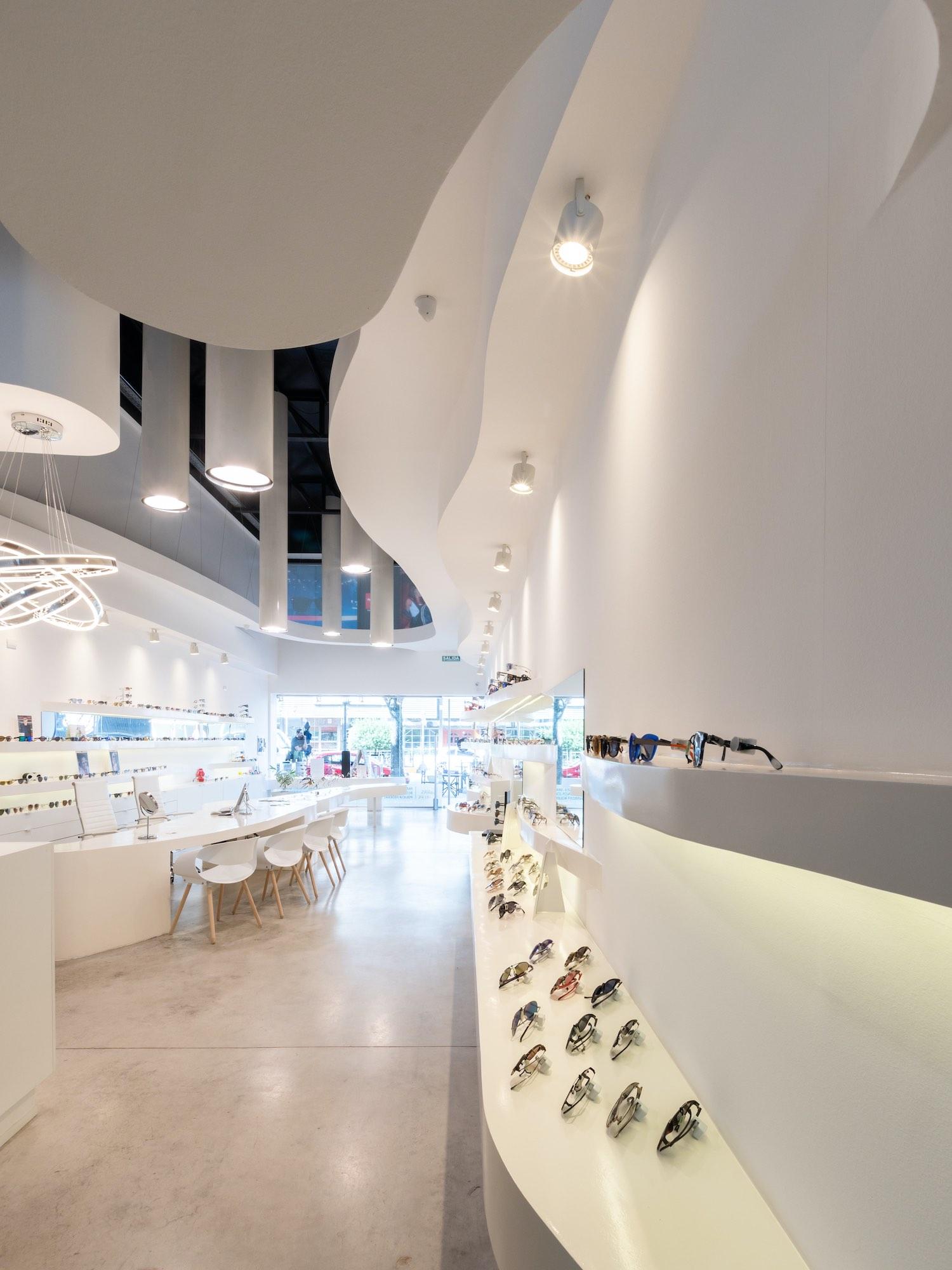 optical shop with curvy ribbon shelves