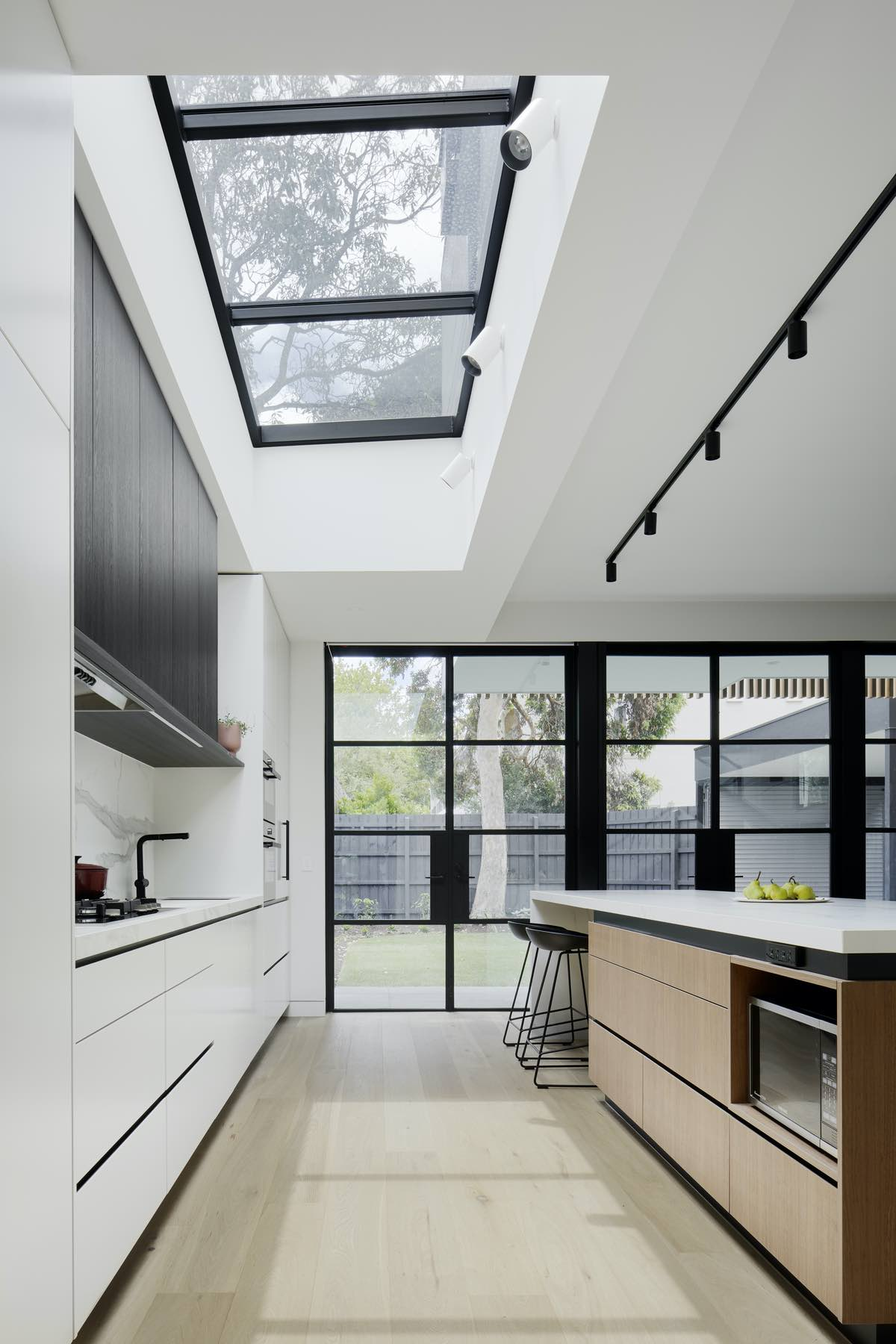 natural light entering the kitchen through skylight in the ceiling