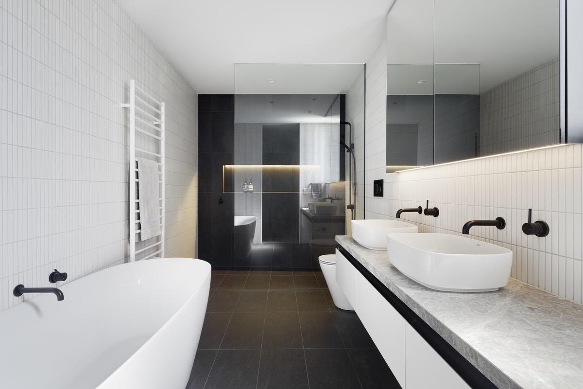 white bathtub and washing basin used in this modern bathroom