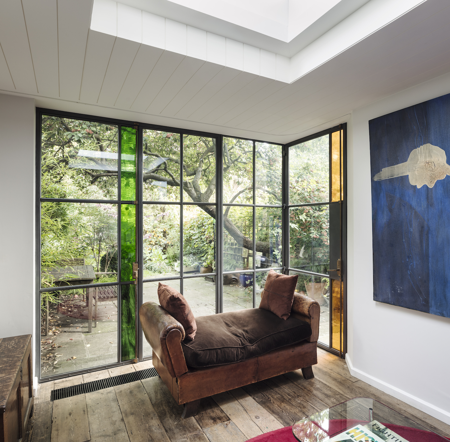 cozy living room with window view to garden