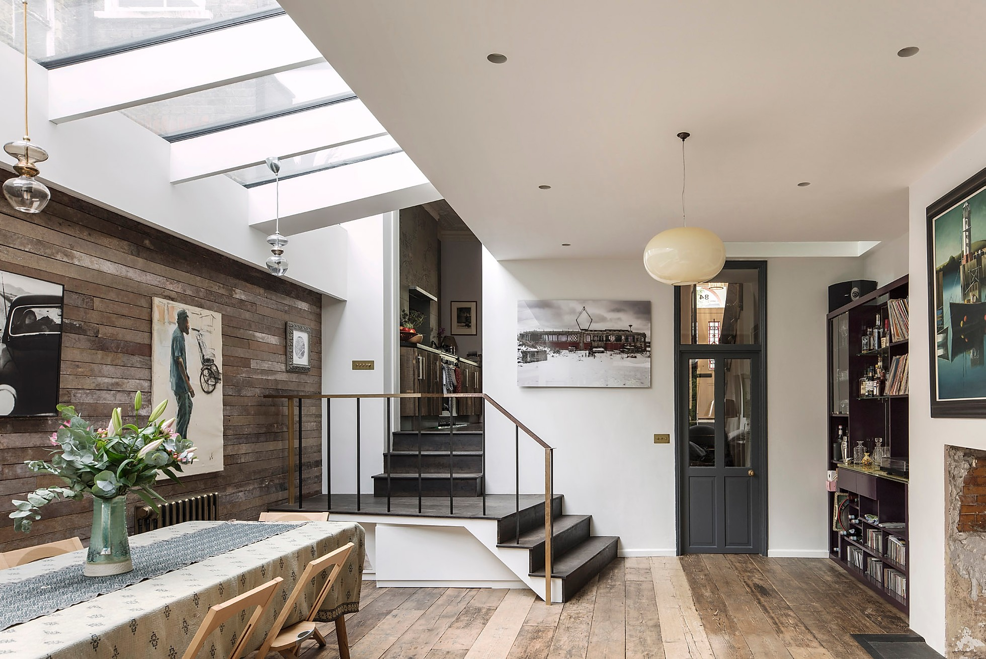 the skylight in the roof let natural sun light enters the living room