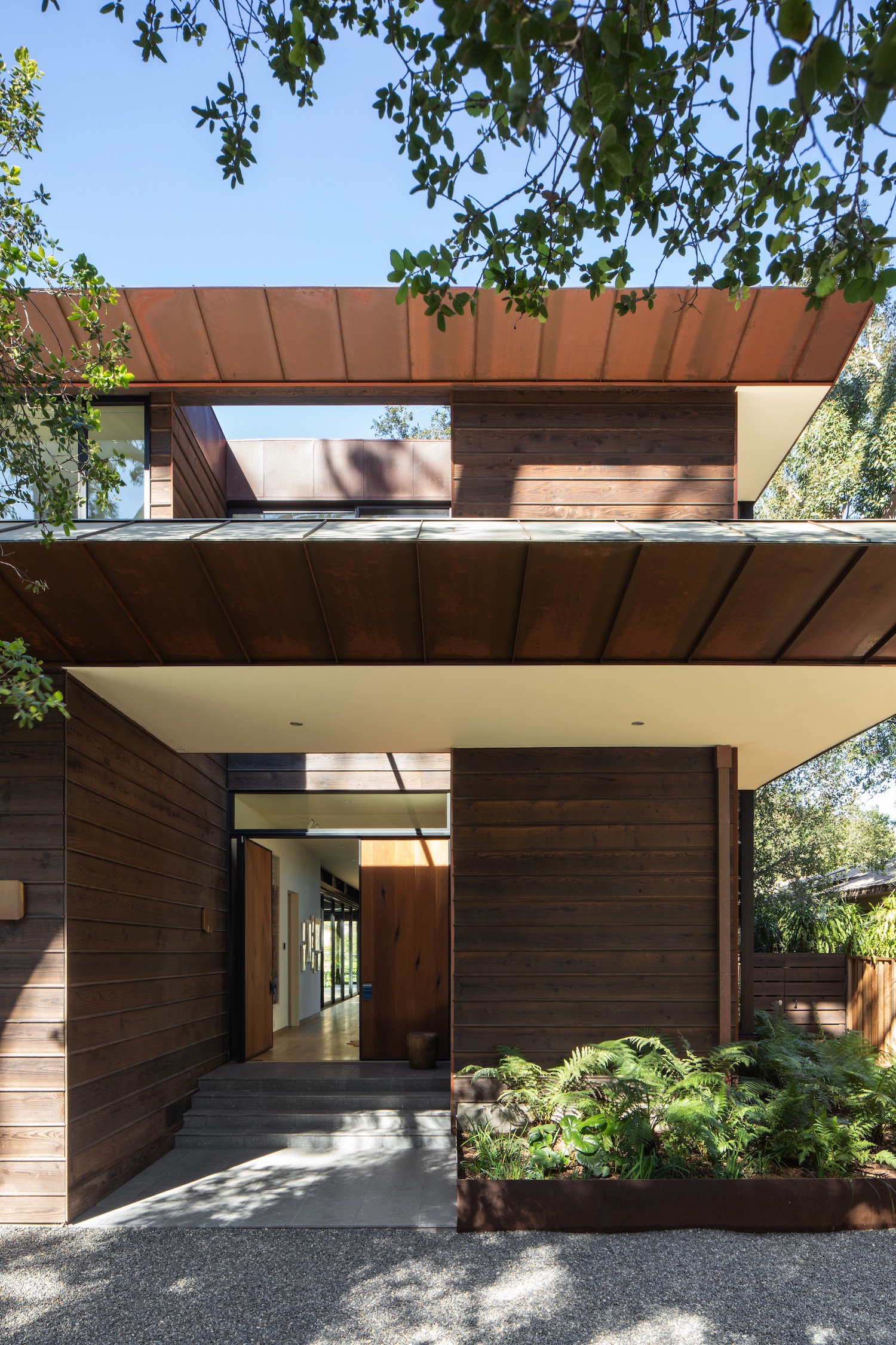the house facade made with wood material