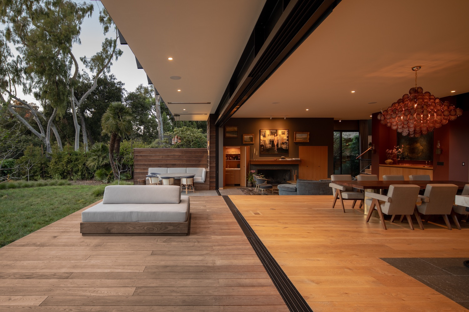 house with deck surrounded by eucalyptus trees