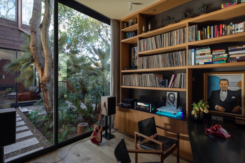 bookshelf with books near the window