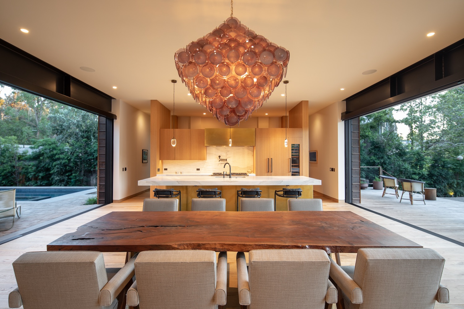 pendant lamp over the wooden dining table in kitchen