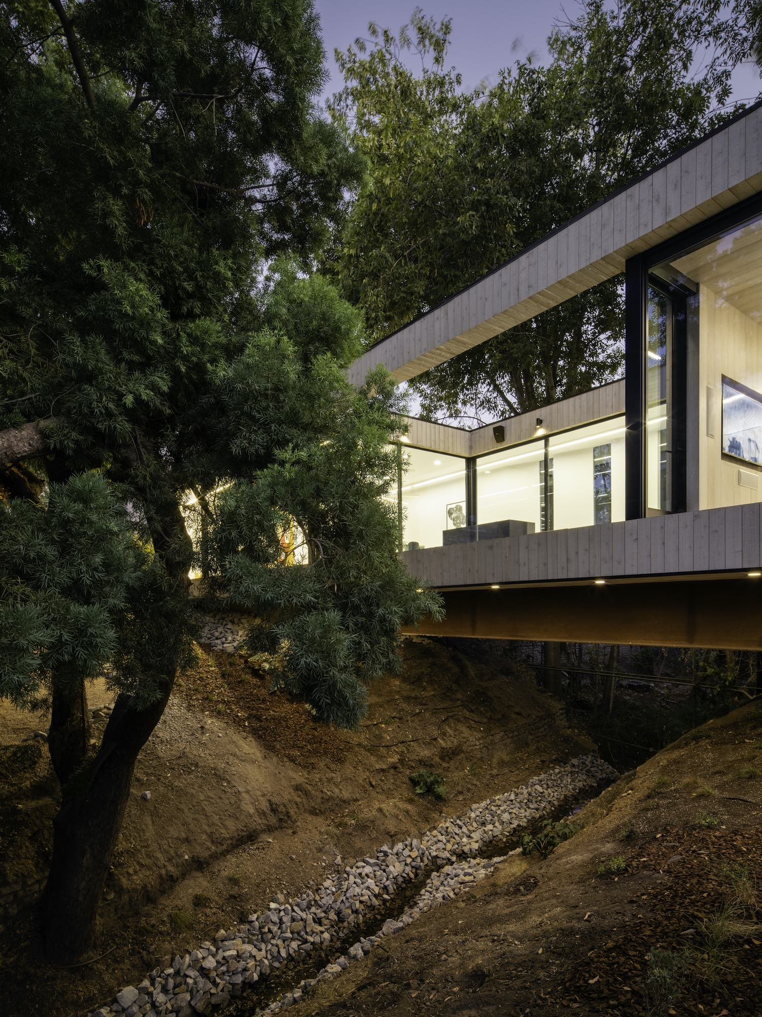bridge house surrounded with trees