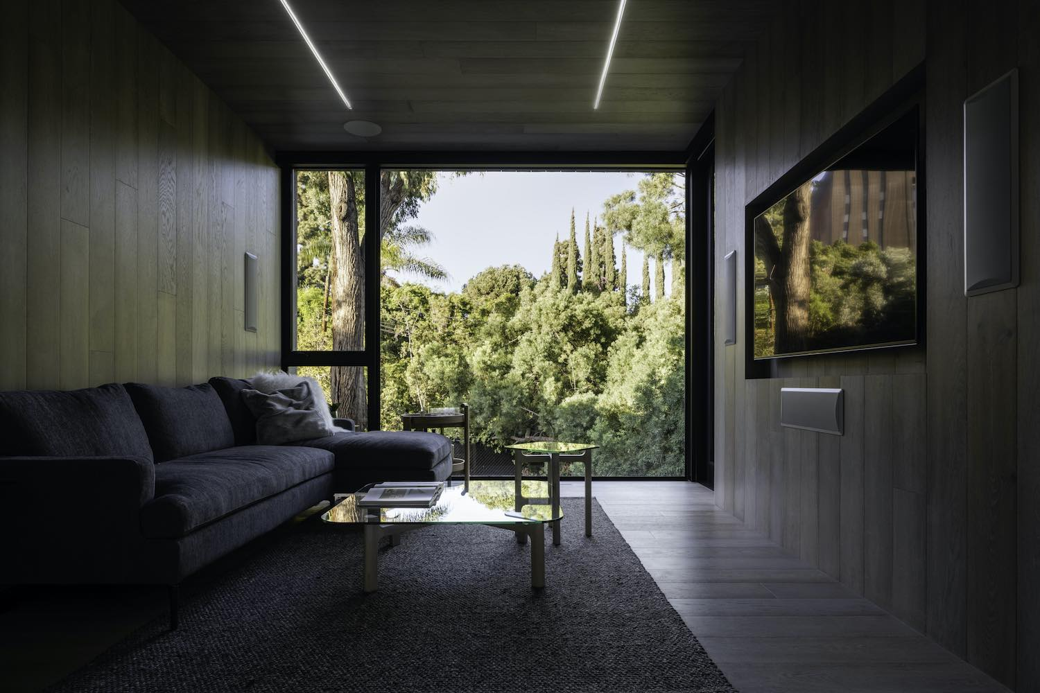 living room with large windows to the backyard