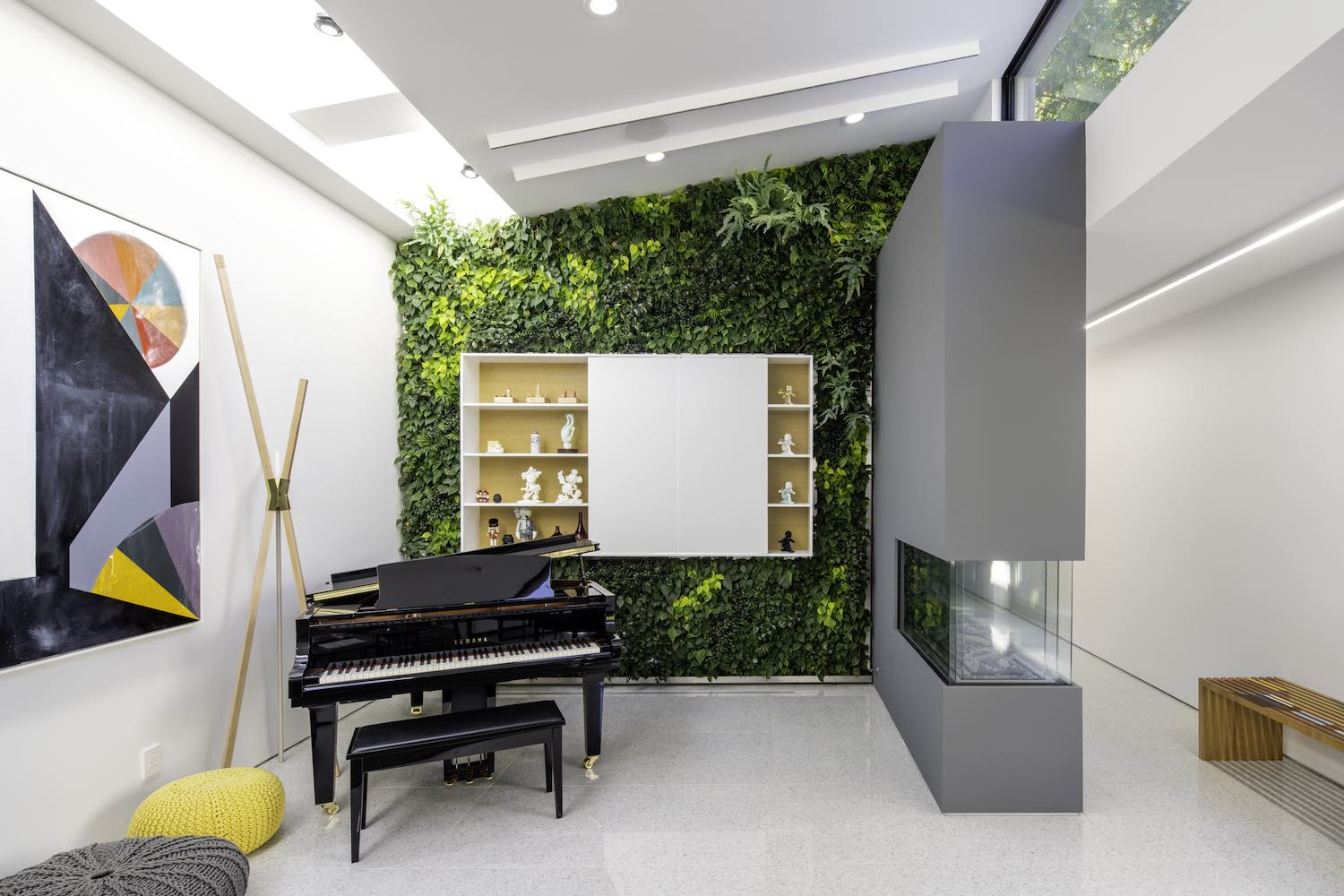 piano in a room with grey wall