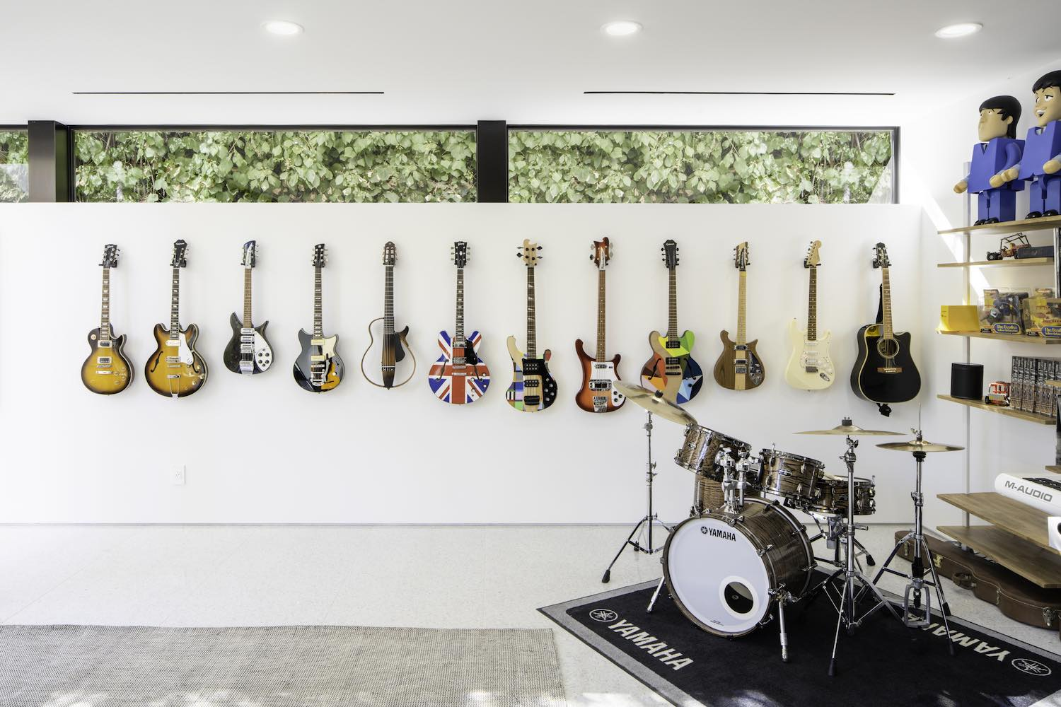 electric guitars hanged on the wall