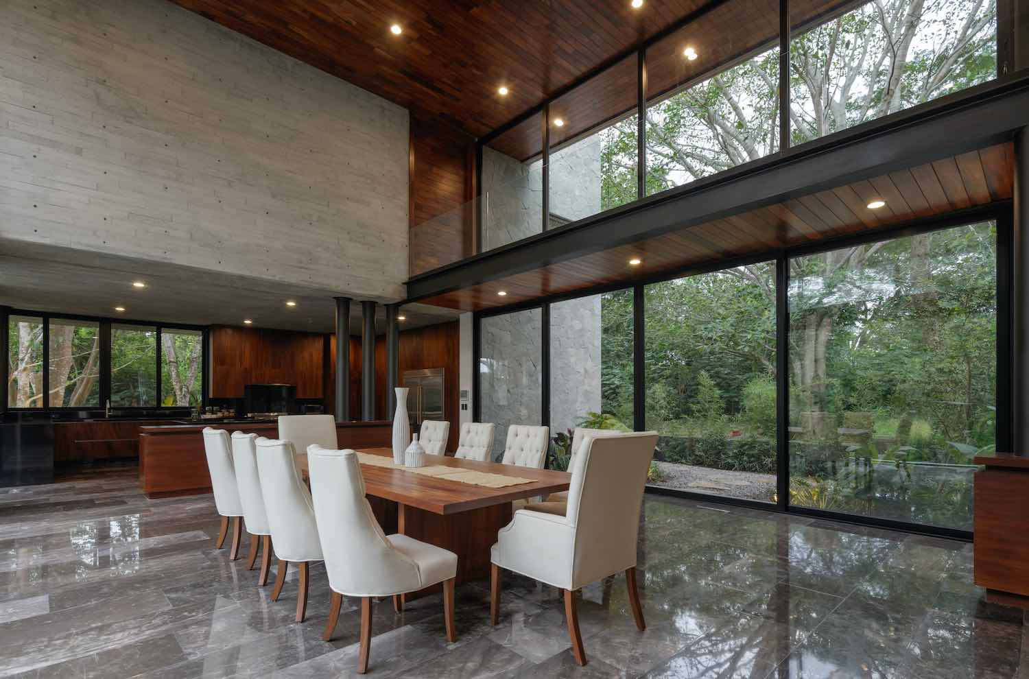 dining area with spectacular nature view though large glass walls