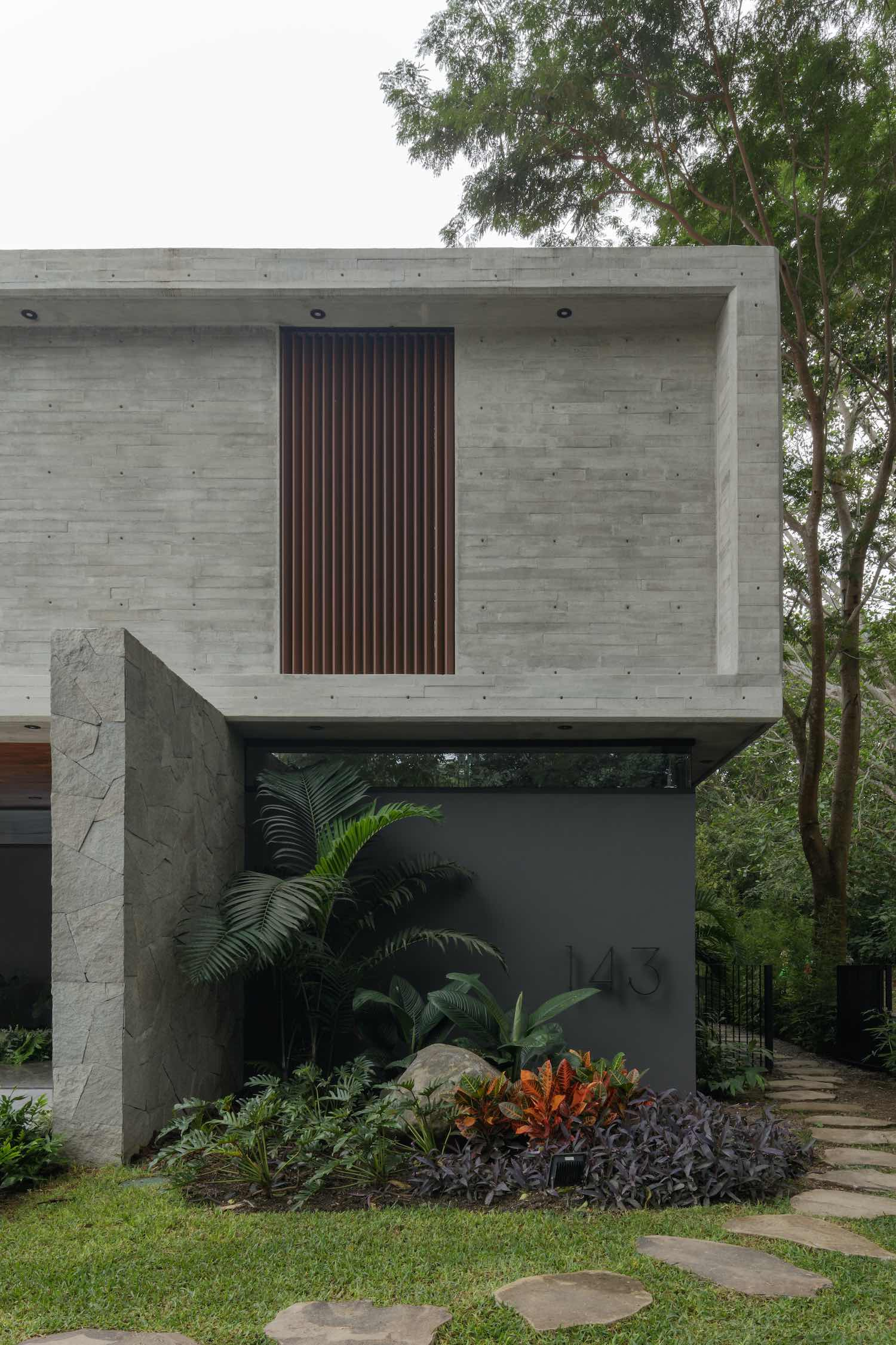 house surrounded with tropical vegetation