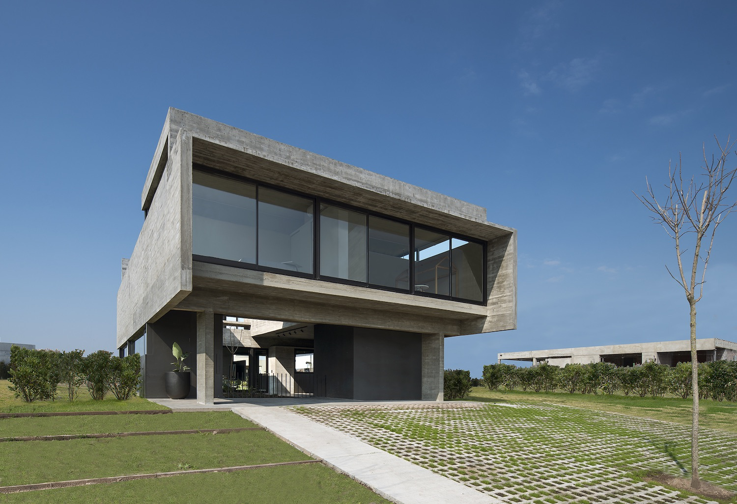 concrete house with green landscape at surrounding