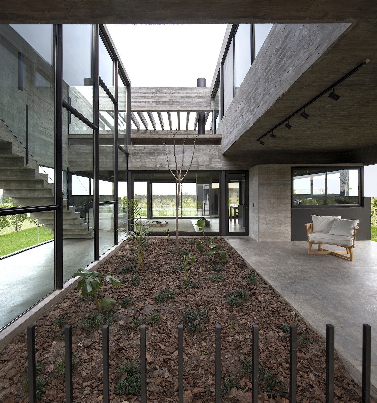 concrete house with indoor courtyard