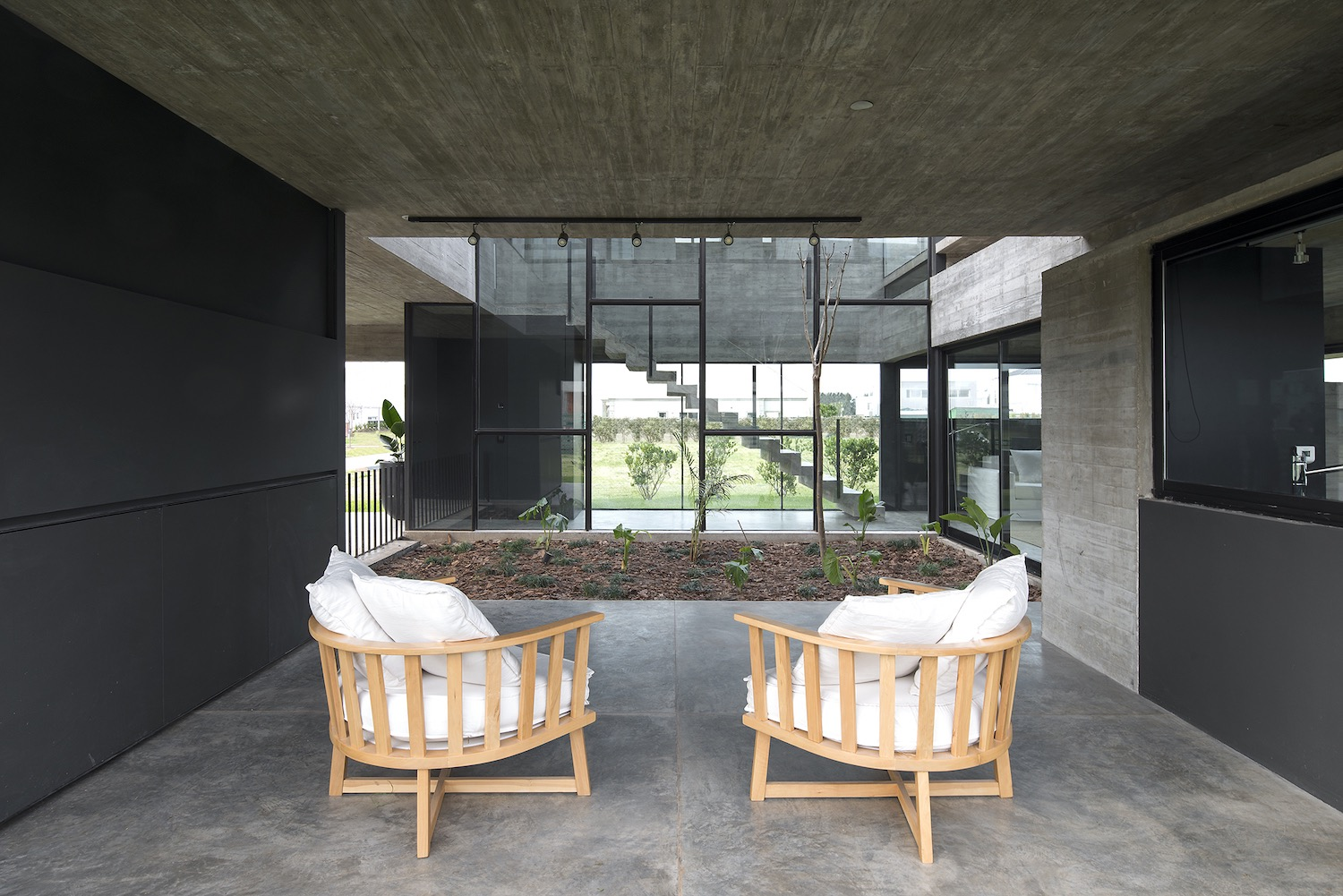 wooden chairs near the indoor courtyard