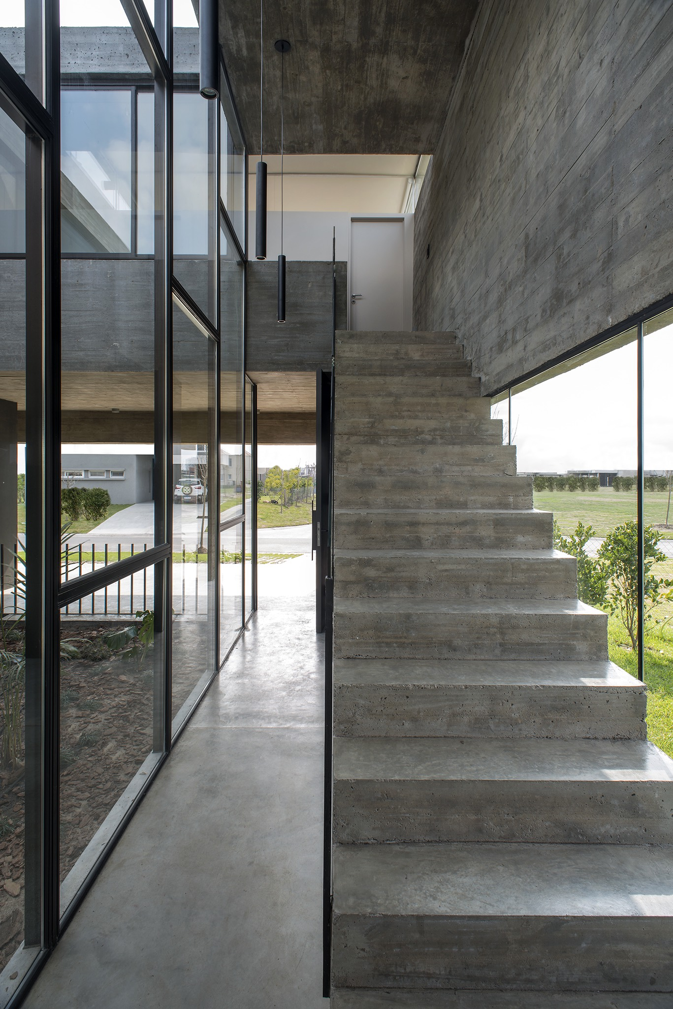 concrete staircase near the glass window