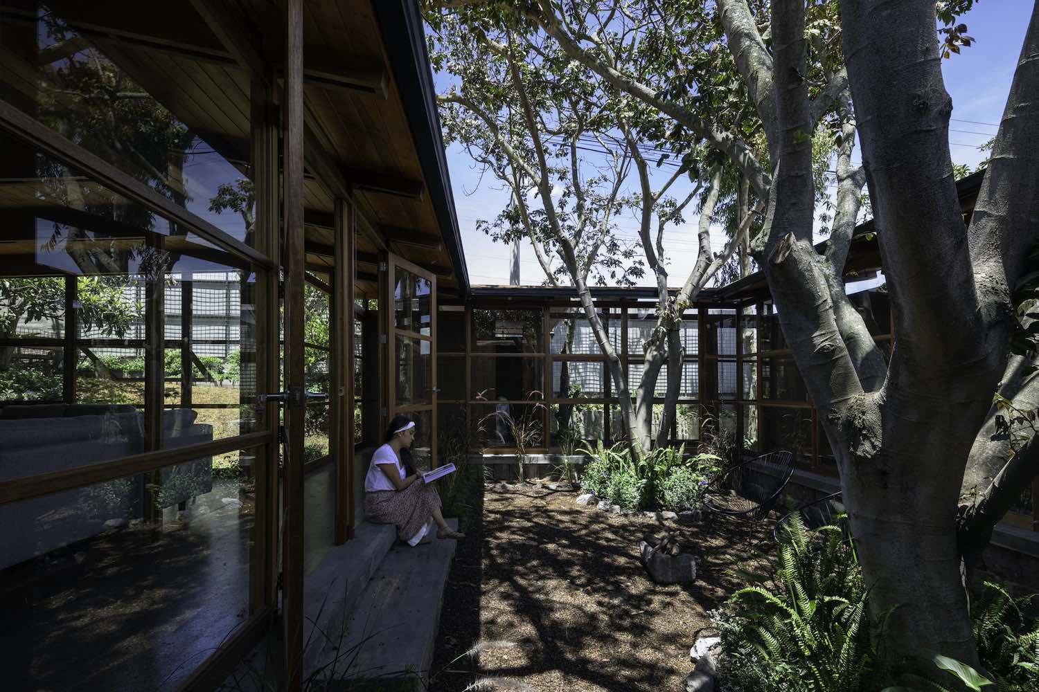 a wooden house among trees in Quito