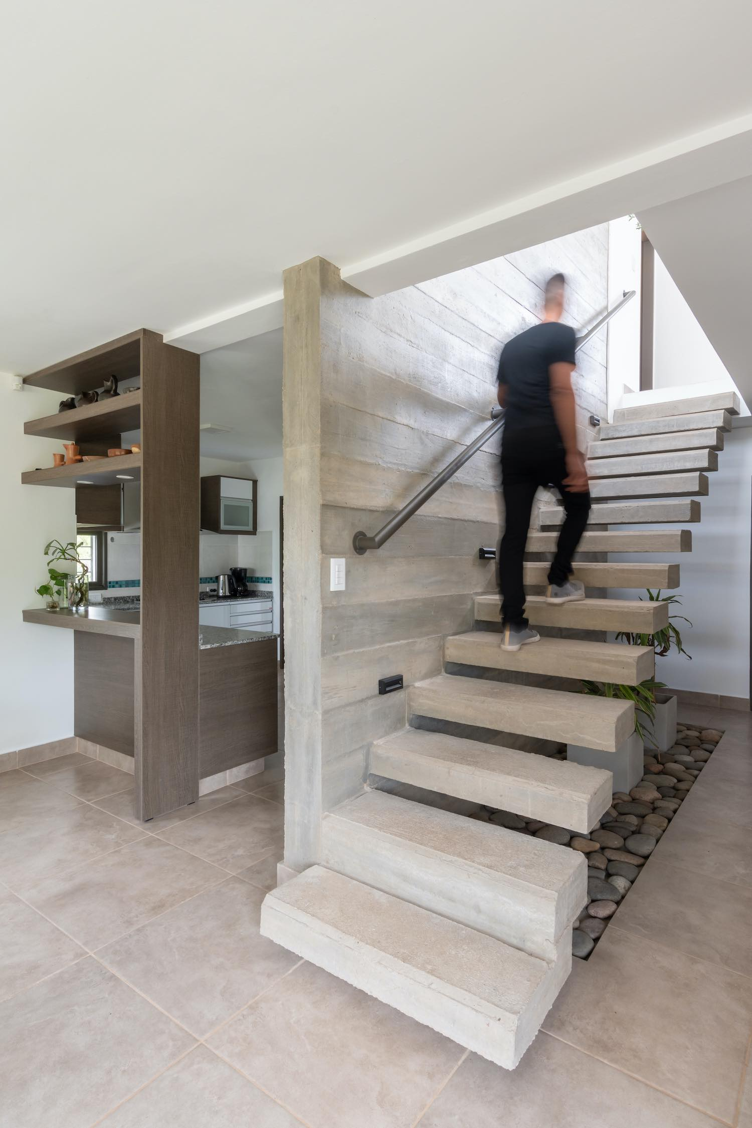 man going upstairs on concrete staircase