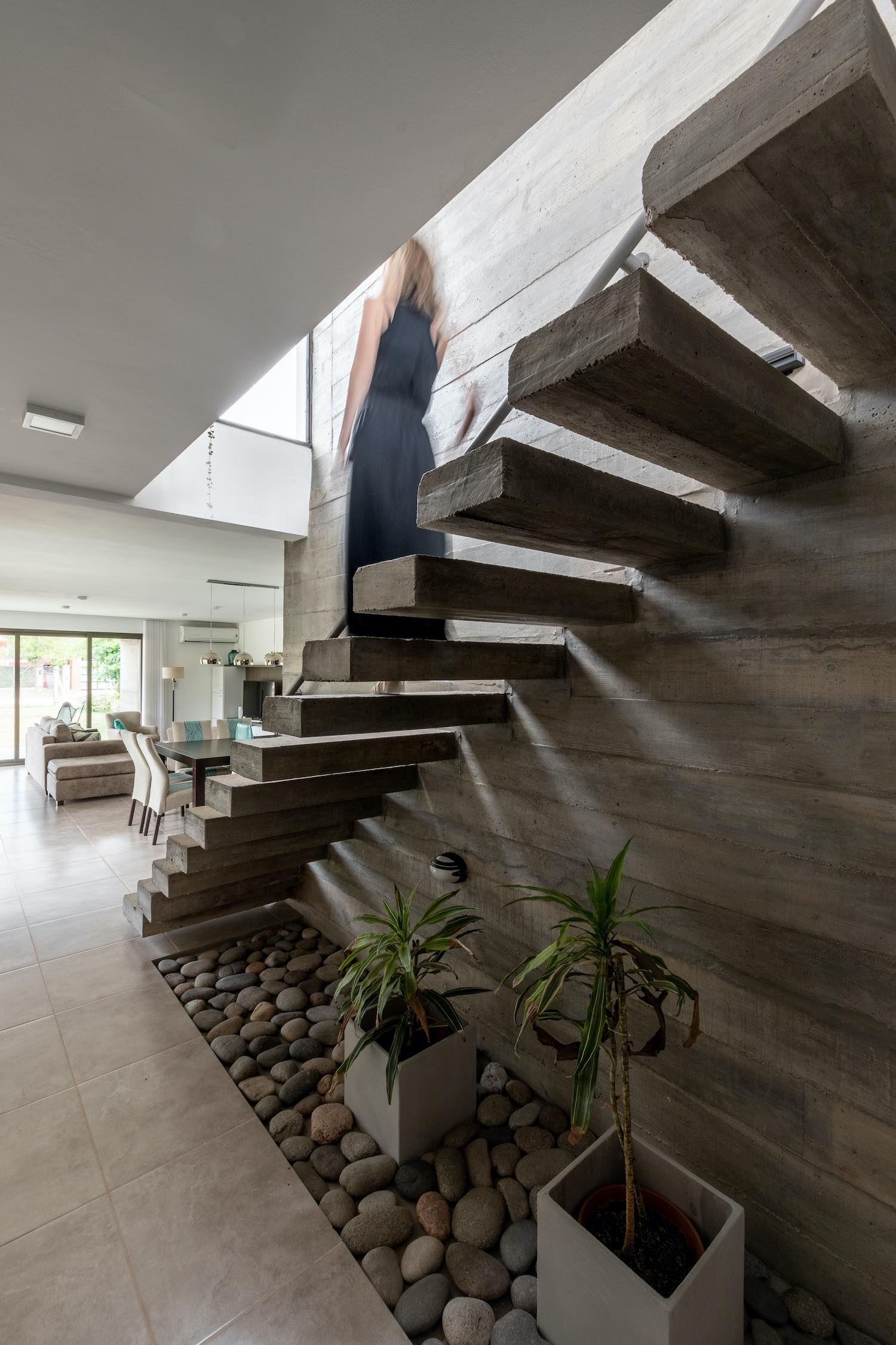 woman going downstairs on a concrete staircase