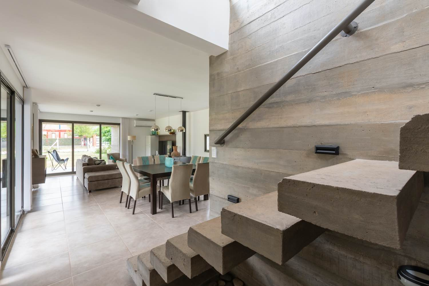 modern concrete staircase without handrail