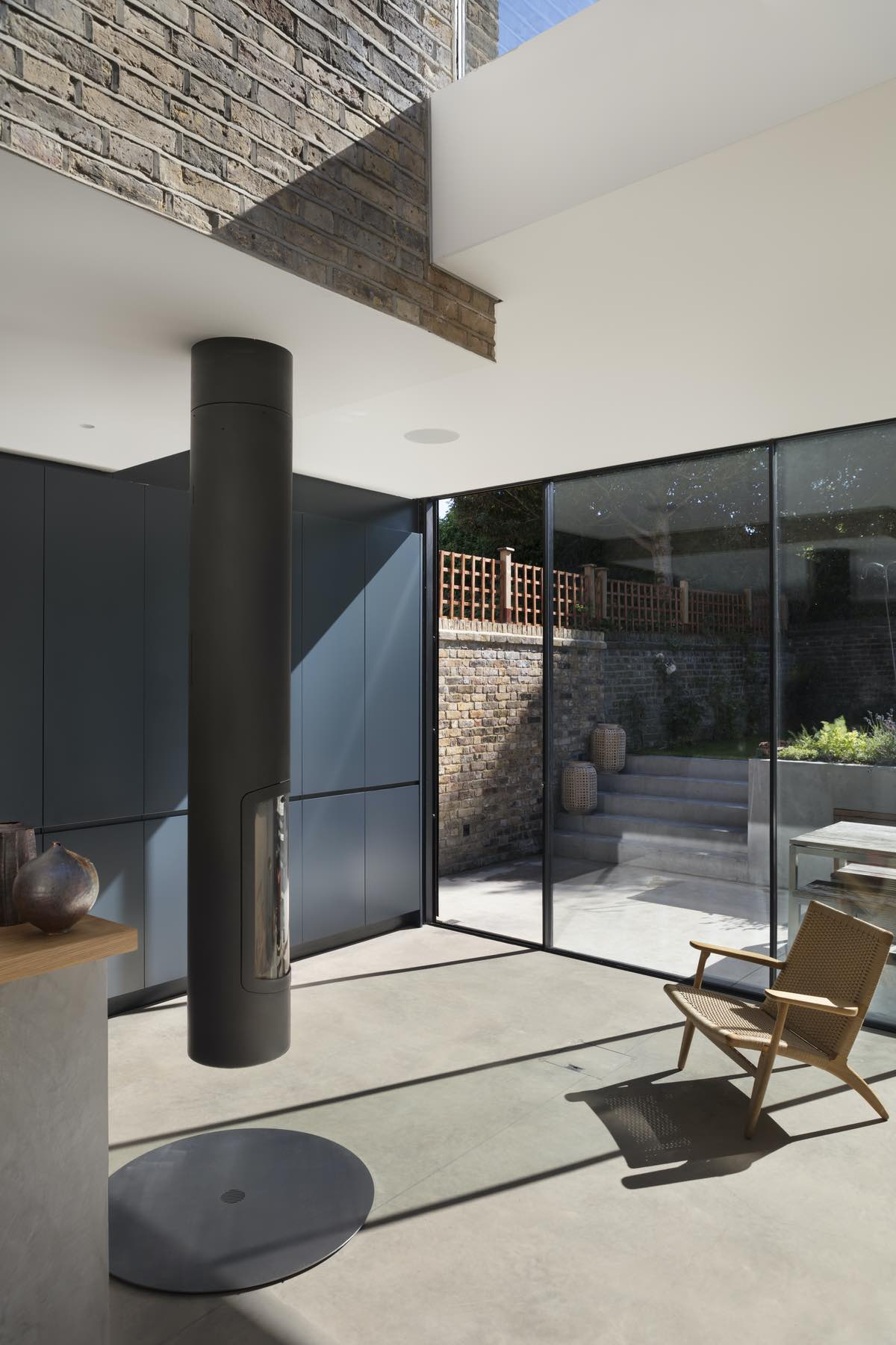 a modern metallic chimney in the kitchen and dining area