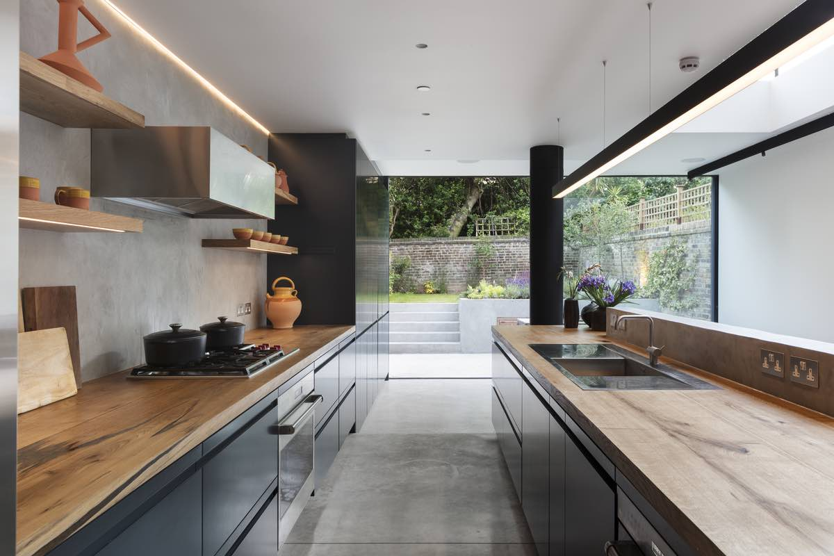 a contemporary kitchen with opening sliding door to the outdoor garden