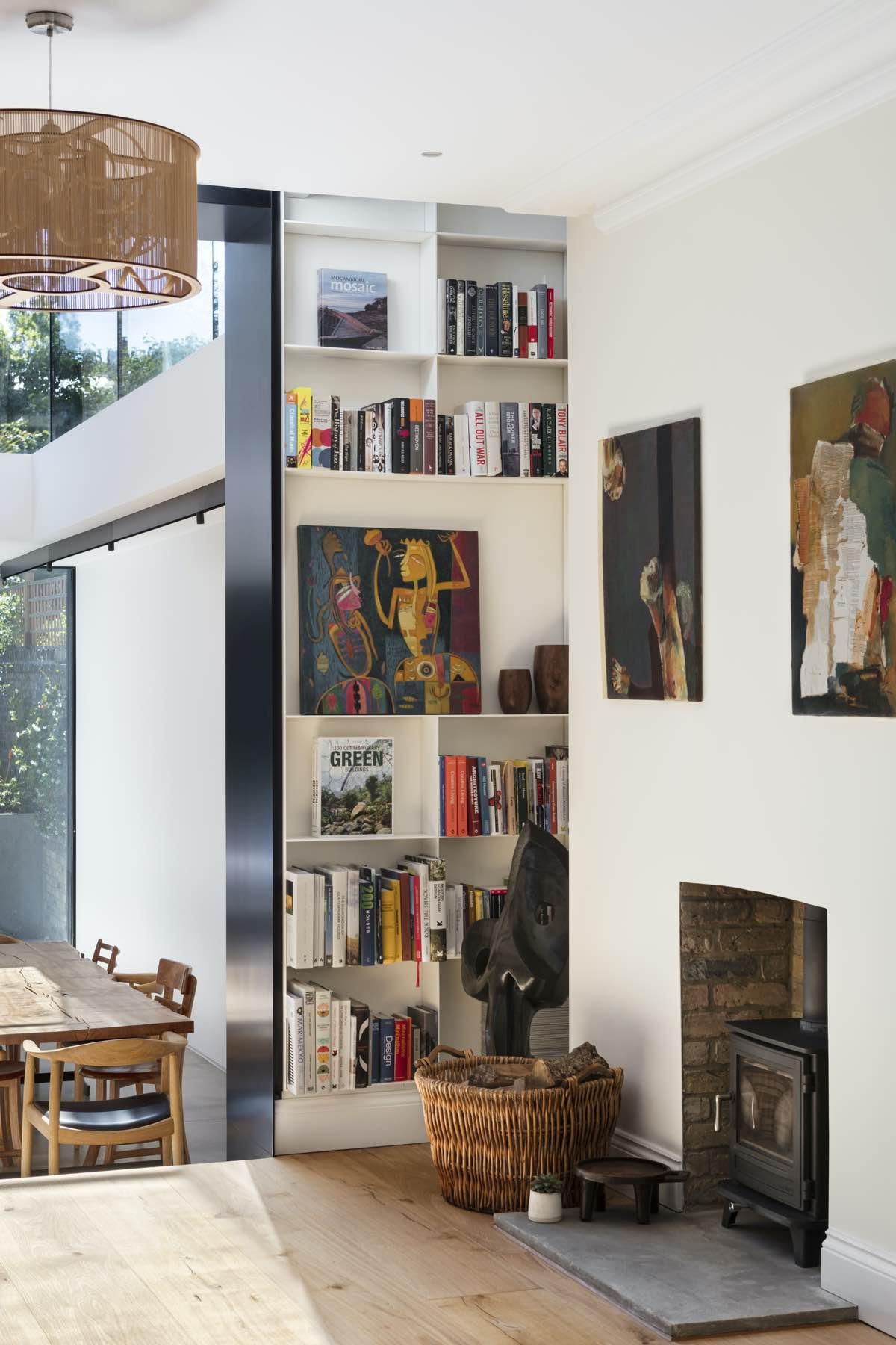 office area with many books inside the bookshelf